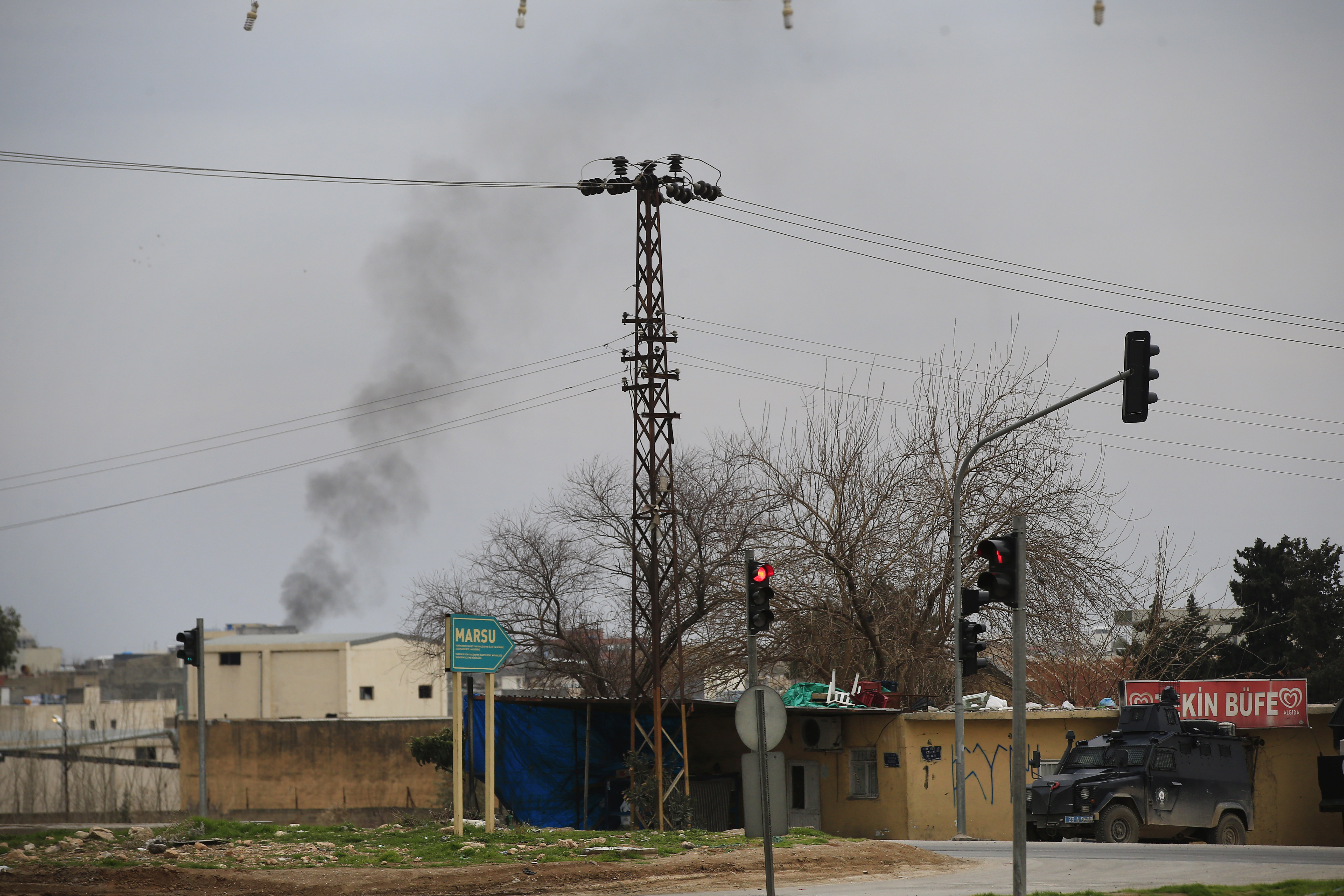 Smoke billows from a fire at the southeastern town of Nusaybin, Turkey, near the border with Syria, where Turkish security forces are battling militants linked to the outlawed Kurdistan Workers, Party or PKK, Sunday, Feb. 14, 2016.
