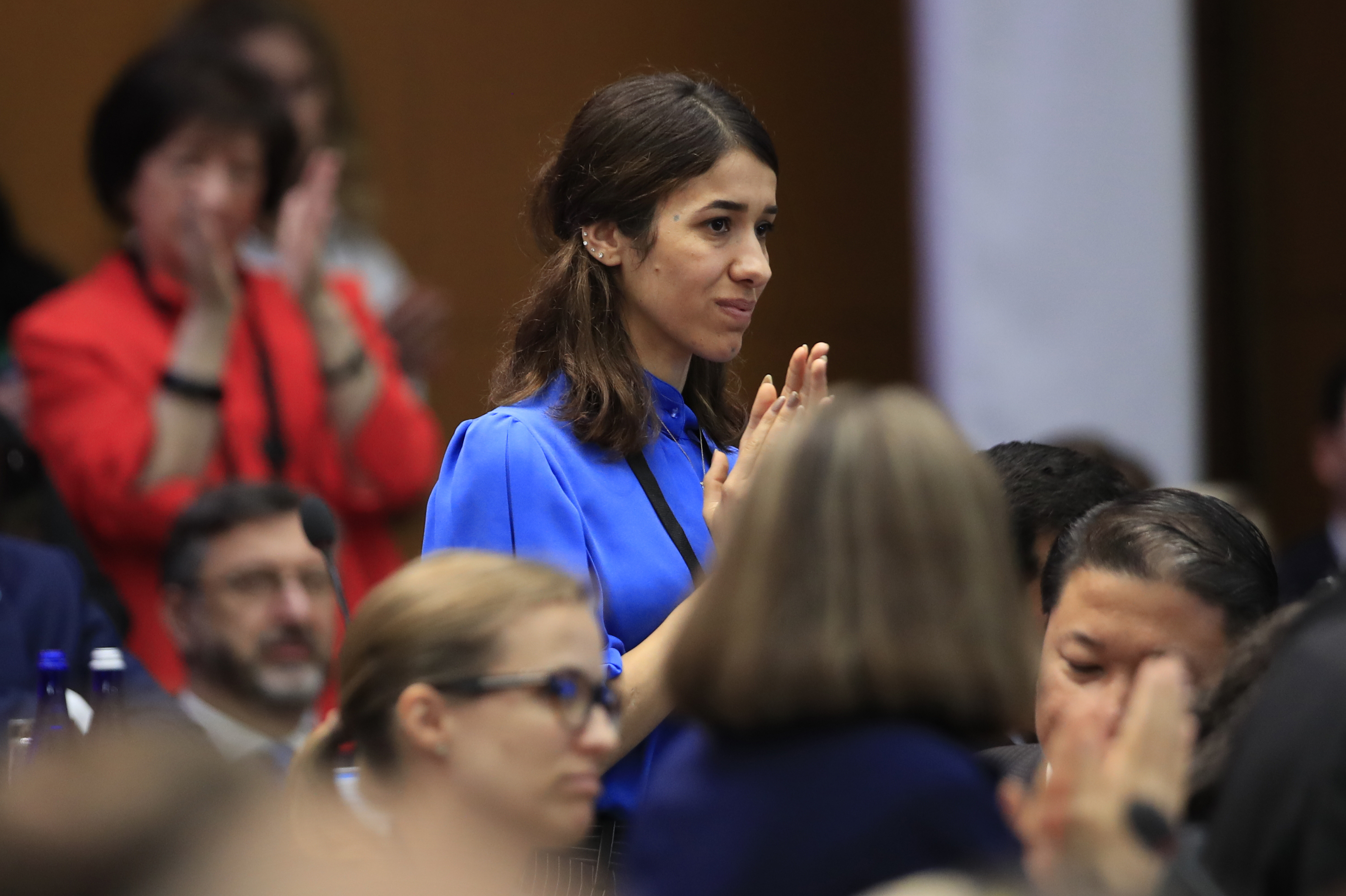 Nadia Murad, a member of the Yazidi religious minority in Iraq and former captive and sex slave of the terrorist group Islamic State, is recognized by Vice President Mike Pence during a speech at the State Department, July 26, 2018.