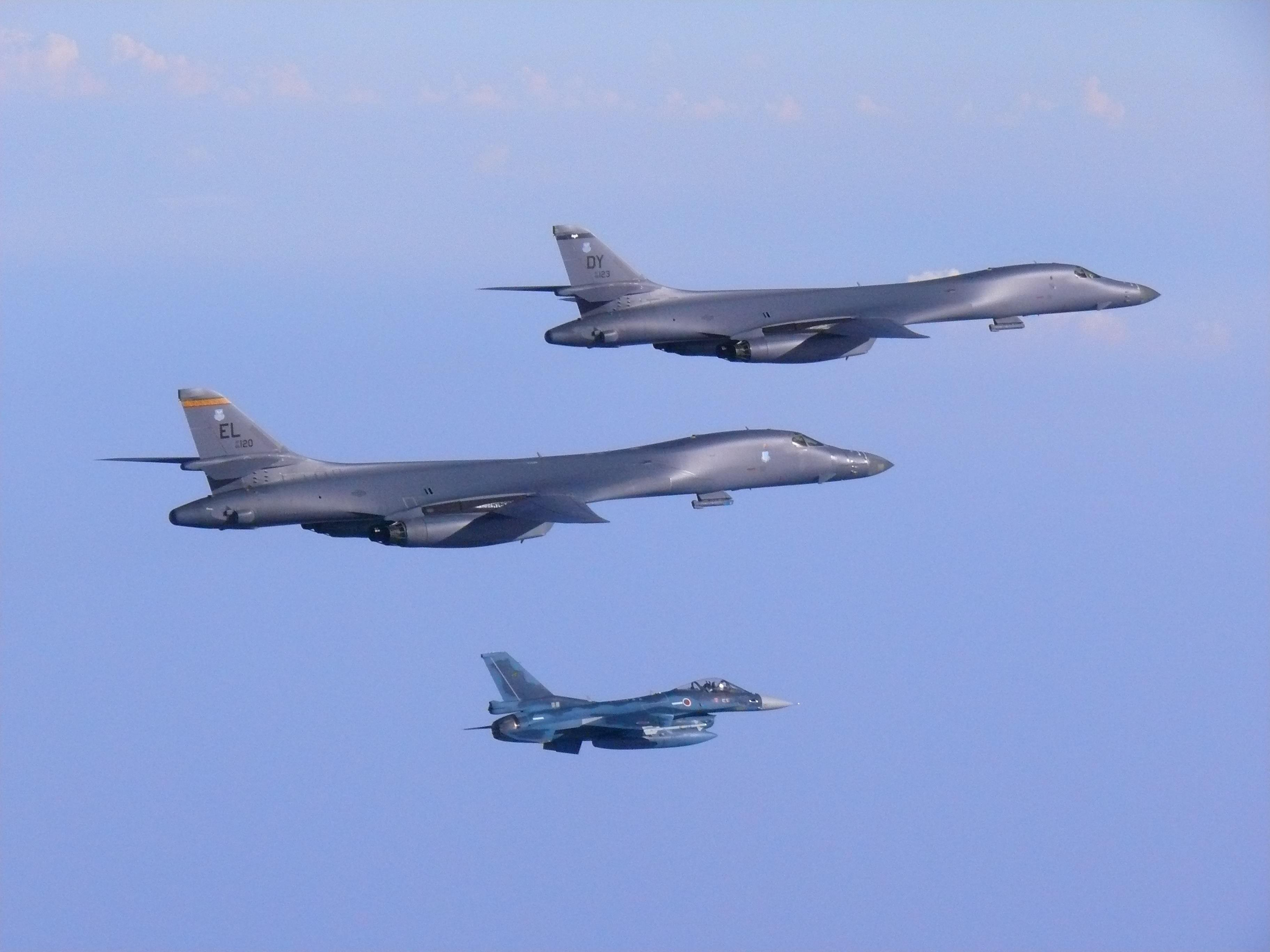 Two U.S. Air Force B-1B Lancers fly from Andersen Air Force Base, Guam, into Japanese airspace and over the Korean Peninsula, July 30, 2017. The B-1s made contact with Japan Air Self-Defense Force F-2 fighter jets in Japanese airspace, then proceeded...