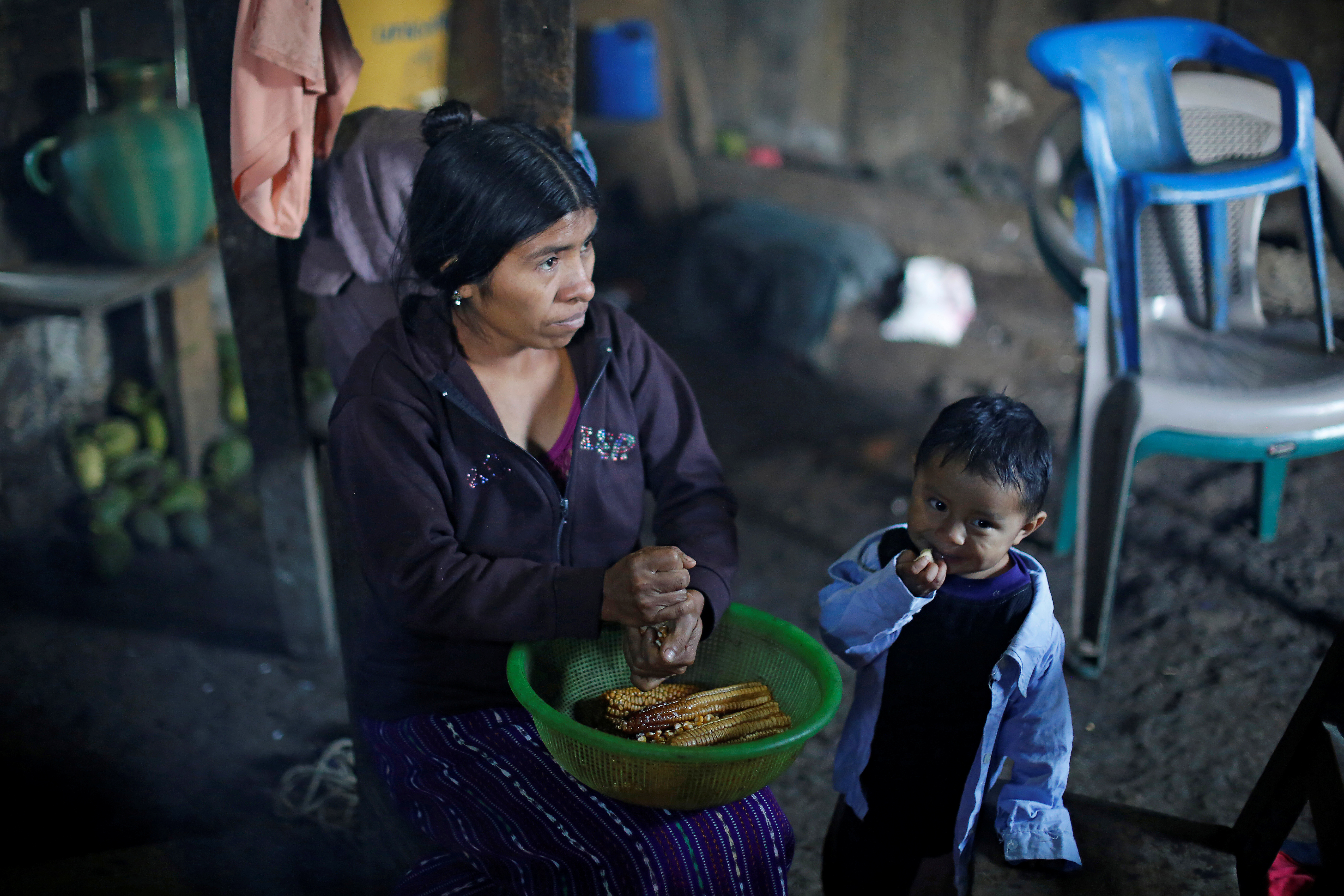 Catarina Alonzo, mother of Felipe Gomez Alonzo, a 8-year-old boy detained along his father for illegally entering the U.S., who fell ill and died in the custody of U.S. Customs and Border Protection (CBP), dekernels maize at her home in the village o...