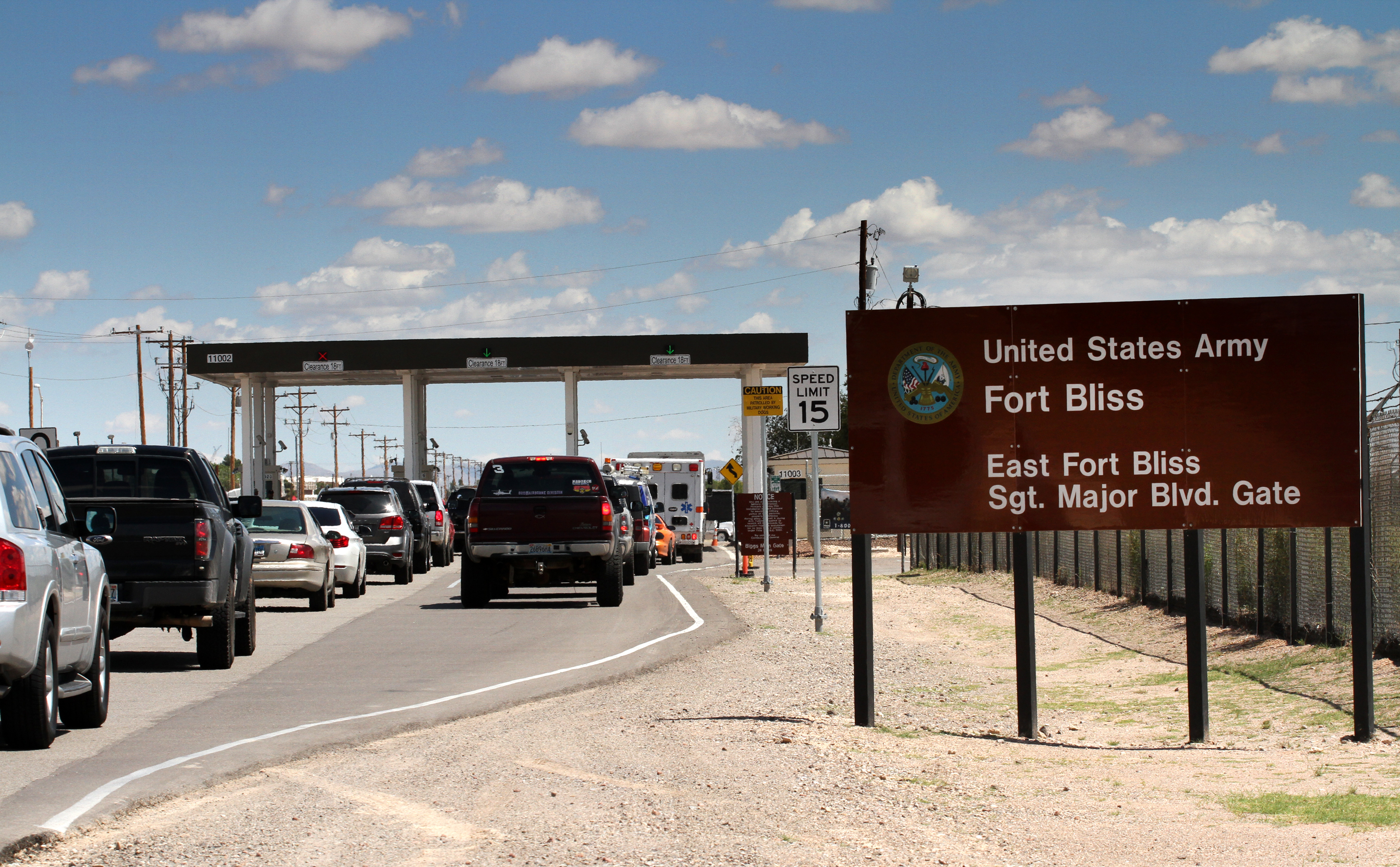 FILE - This Sept. 9, 2014 file photo shows cars wait to enter Fort Bliss in El Paso, Texas. The base is one of three Texas military properties to be considered as a shelter location for unaccompanied migrant children.