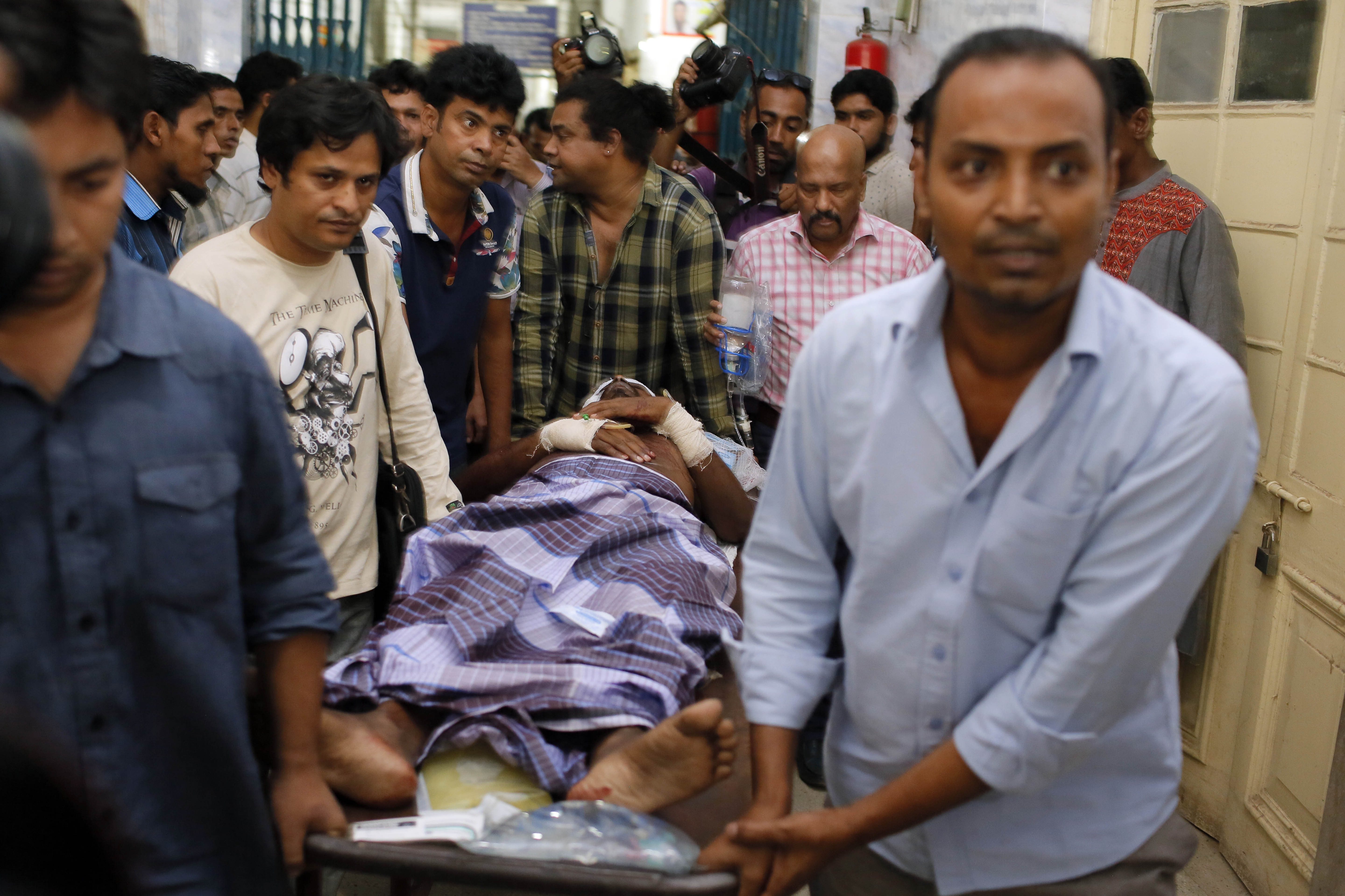 Іnjured publisher Ahmed Rahim Tutul is carried on a stretcher to the Dhaka Medical College Hospital in Dhaka, Bangladesh, Oct. 31, 2015.