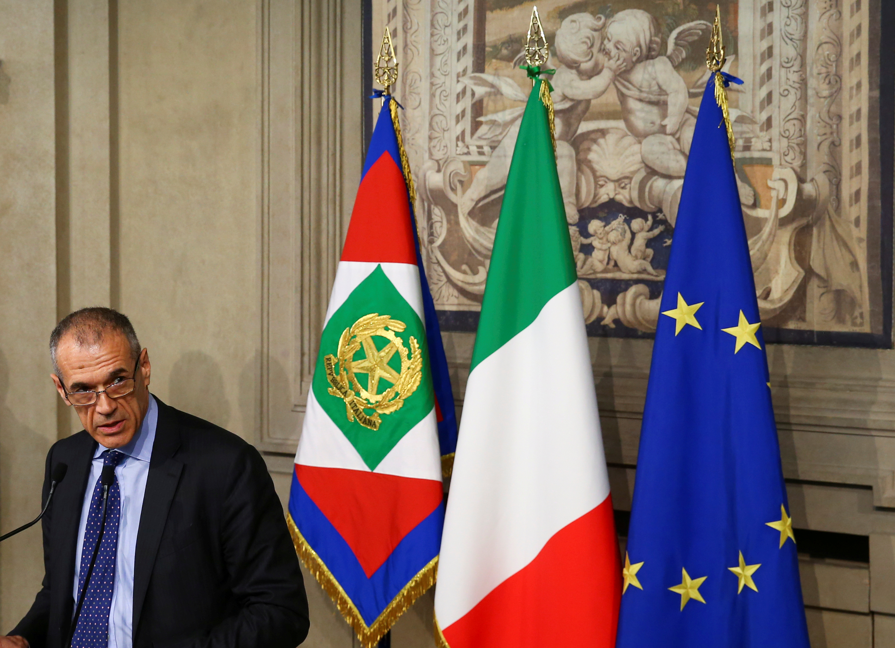 FILE - Former senior International Monetary Fund (IMF) official Carlo Cottarelli speaks to the media after a meeting with Italy's President Sergio Mattarella at the Quirinal Palace in Rome, Italy, May 28, 2018.