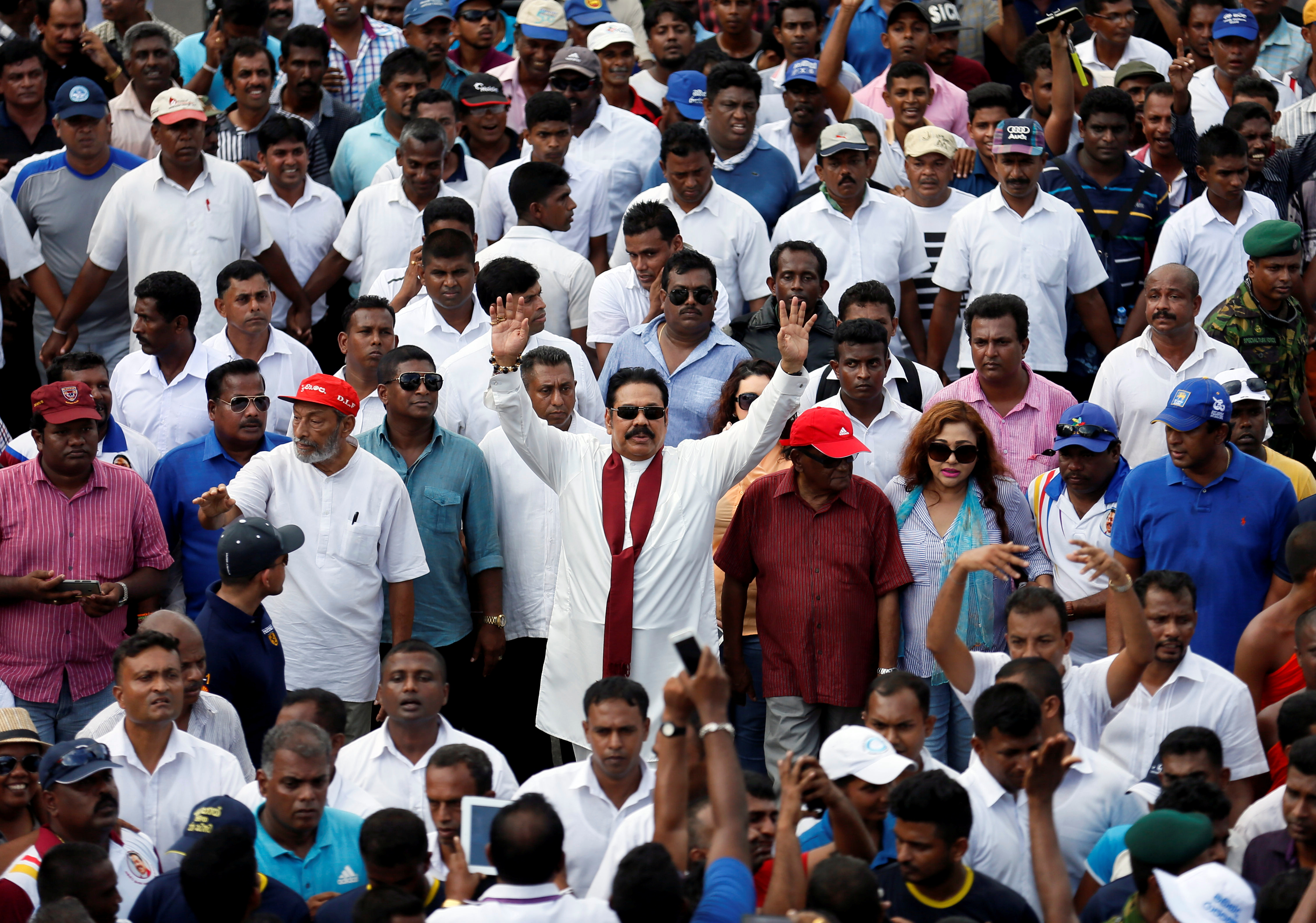 Sri Lanka's former President Mahinda Rajapaksa waves at his supporters at the end of the five-day protest march from Kandy  to Colombo, in Sri Lanka, Aug. 1, 2016.