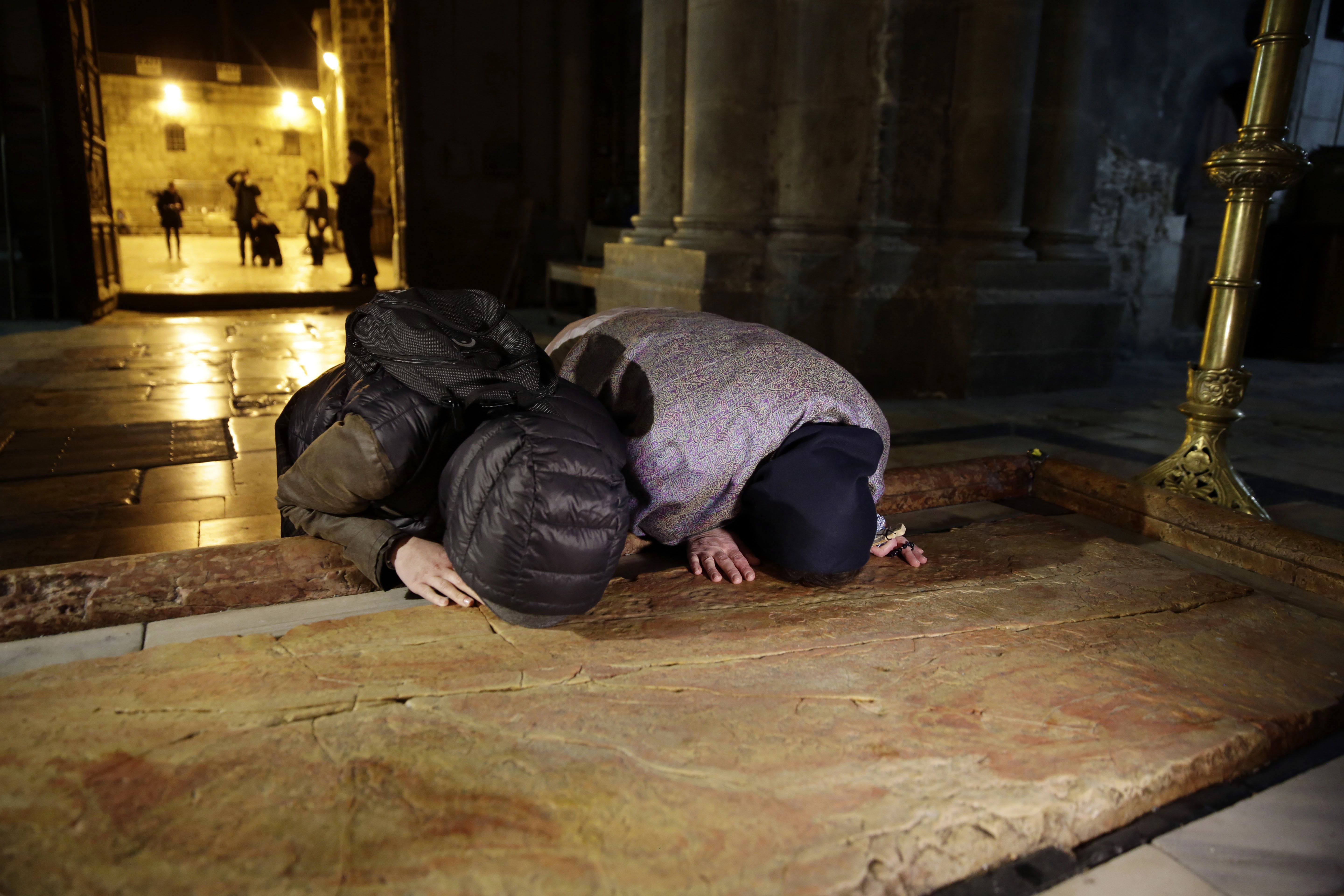 Visitors pray inside the Church of the Holy Sepulcher, traditionally believed by many Christians to be the site of the crucifixion and burial of Jesus Christ, in Jerusalem, Feb. 28, 2018.