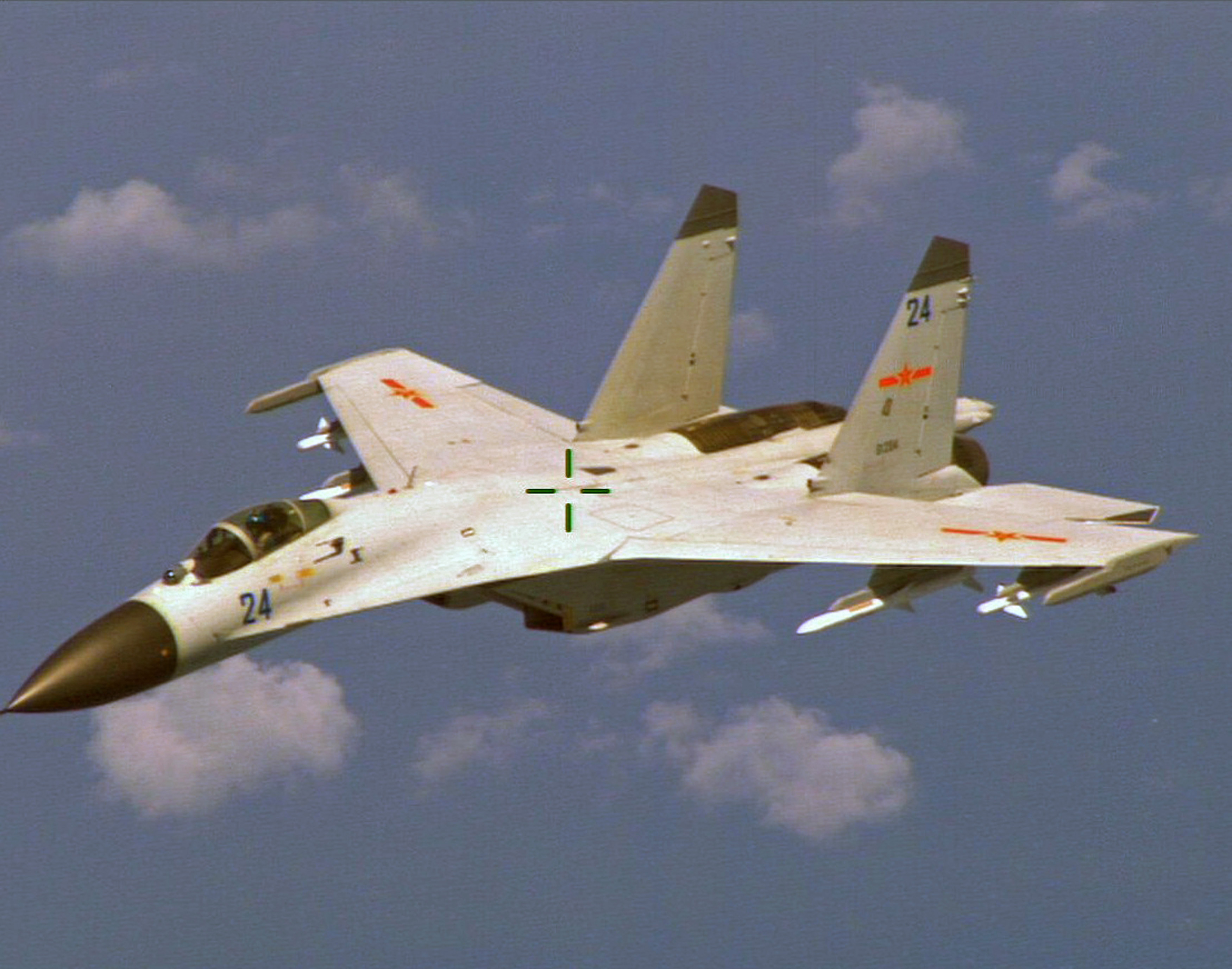A Chinese J-11 fighter jet is seen flying near a U.S. Navy P-8 Poseidon about 215 km (135 miles) east of China's Hainan Island in this U.S. Department of Defense handout photo taken Aug. 19, 2014.