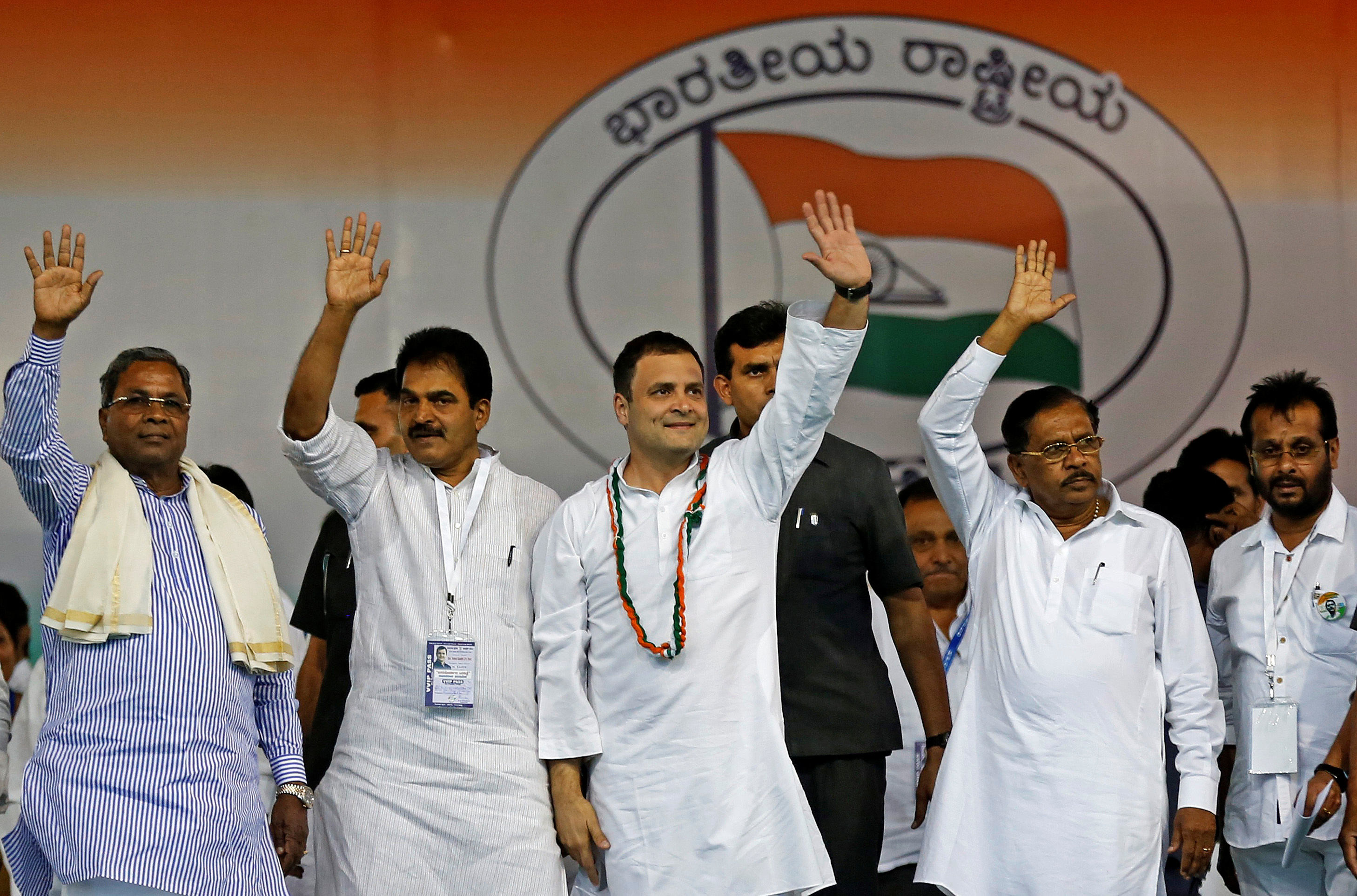 Rahul Gandhi, center, president of India's main opposition Congress party, waves to the crowd before addressing an election campaign rally ahead of the Karnataka state assembly elections, in Bengaluru, India, April 8, 2018.