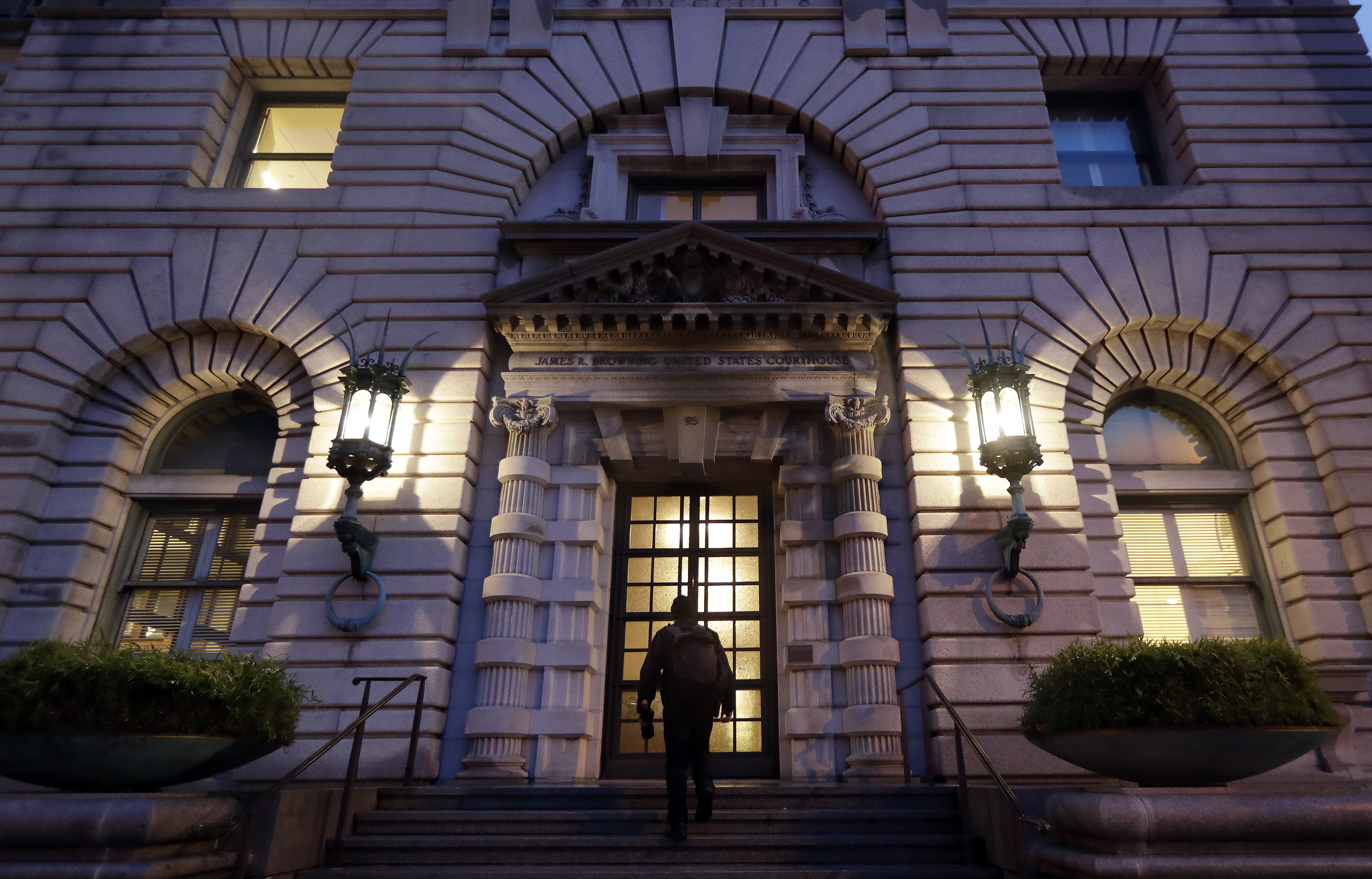 A man walks up the steps of the 9th U.S. Circuit Court of Appeals building, Feb. 9, 2017, in San Francisco. A federal appeals court refused Thursday to reinstate President Donald Trump's ban on travelers from seven predominantly Muslim nations, deal