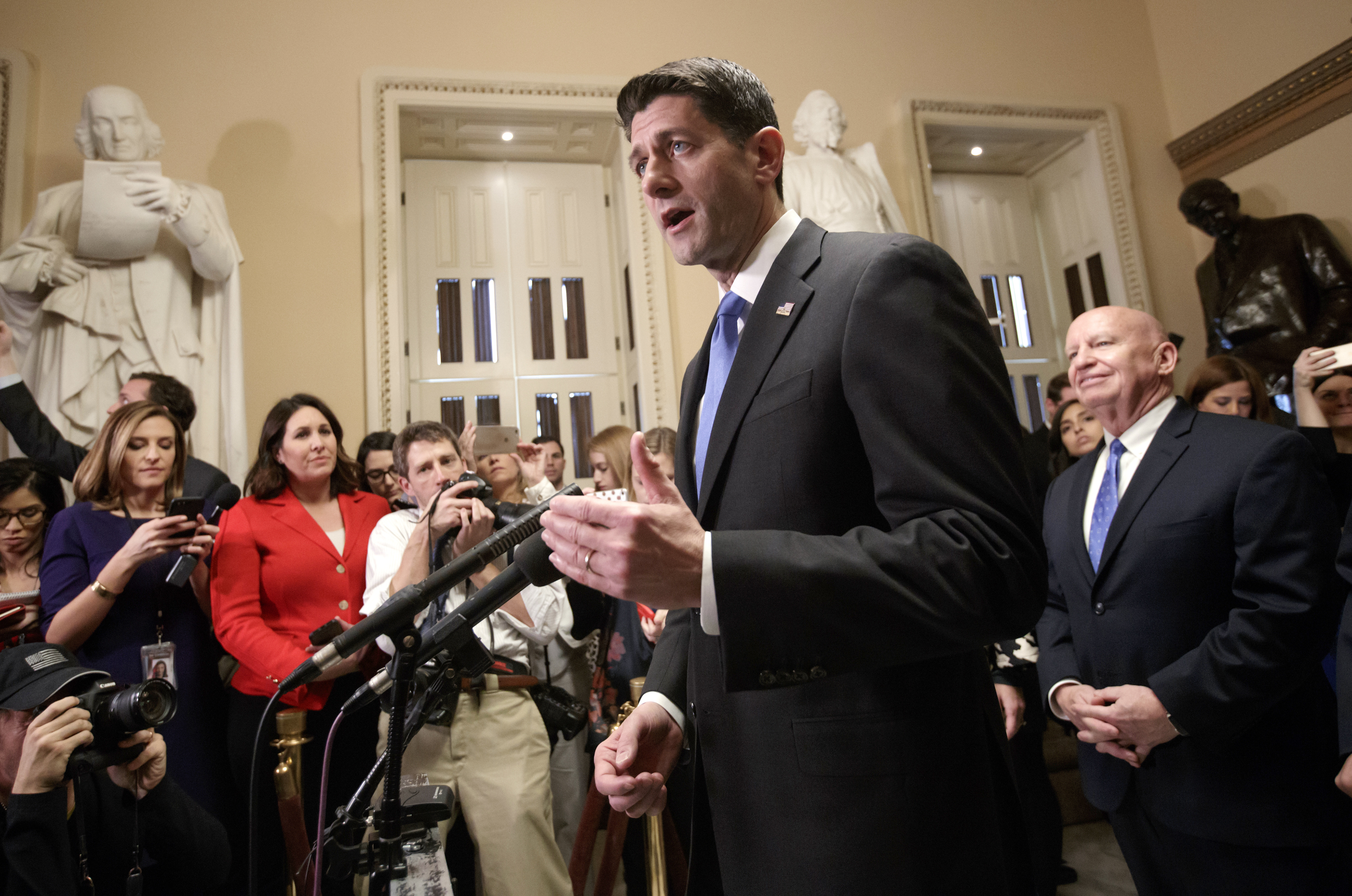 Speaker of the House Paul Ryan, R-Wis., joined at right by House Ways and Means Committee Chairman Kevin Brady, R-Texas, meets reporters just after passing the Republican tax reform bill in the House of Representatives, on Capitol Hill, in Washington...
