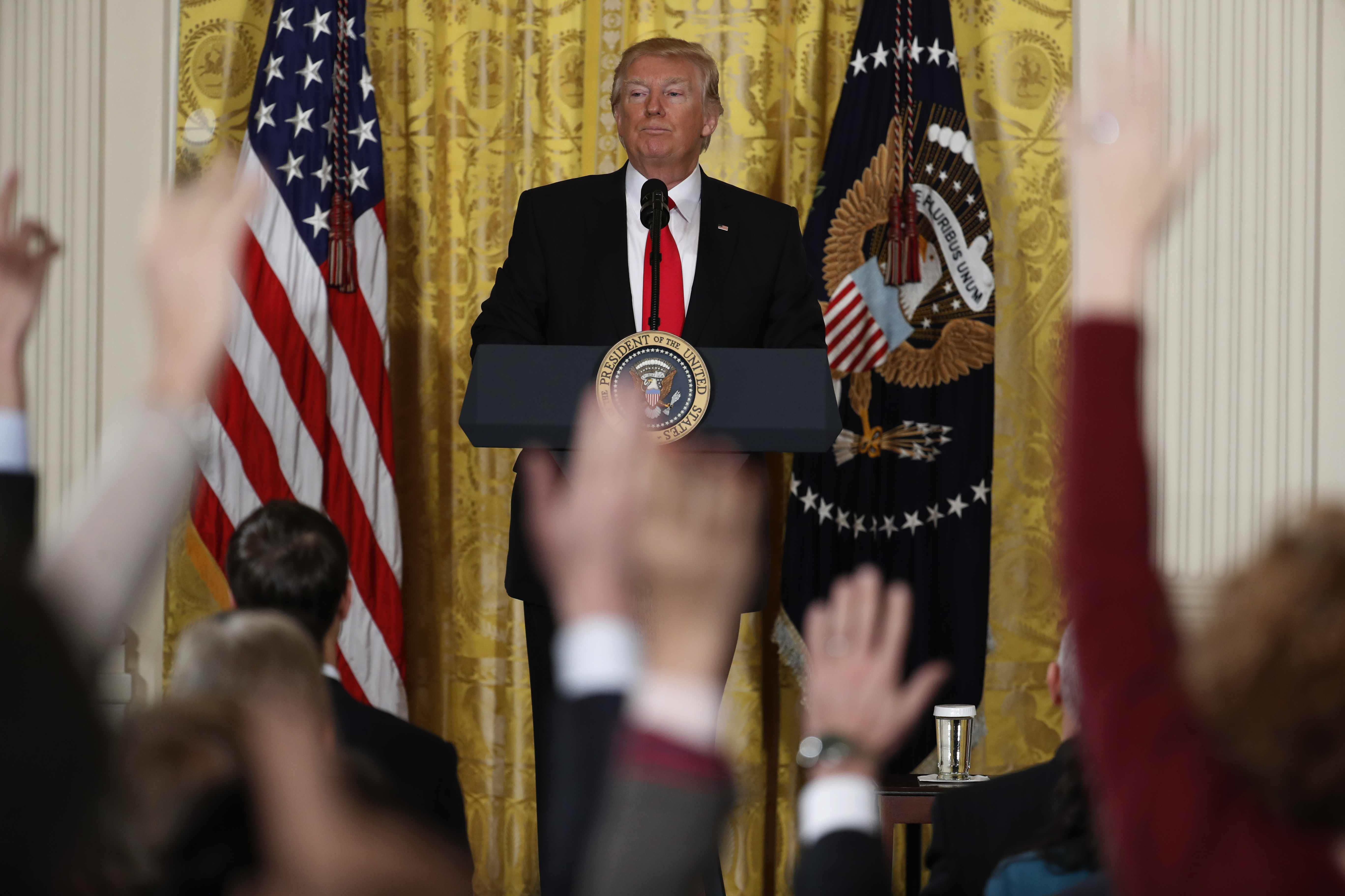 President Donald Trump looks at reporters during a news conference in the East Room of the White House in Washington, Feb. 16, 2017.