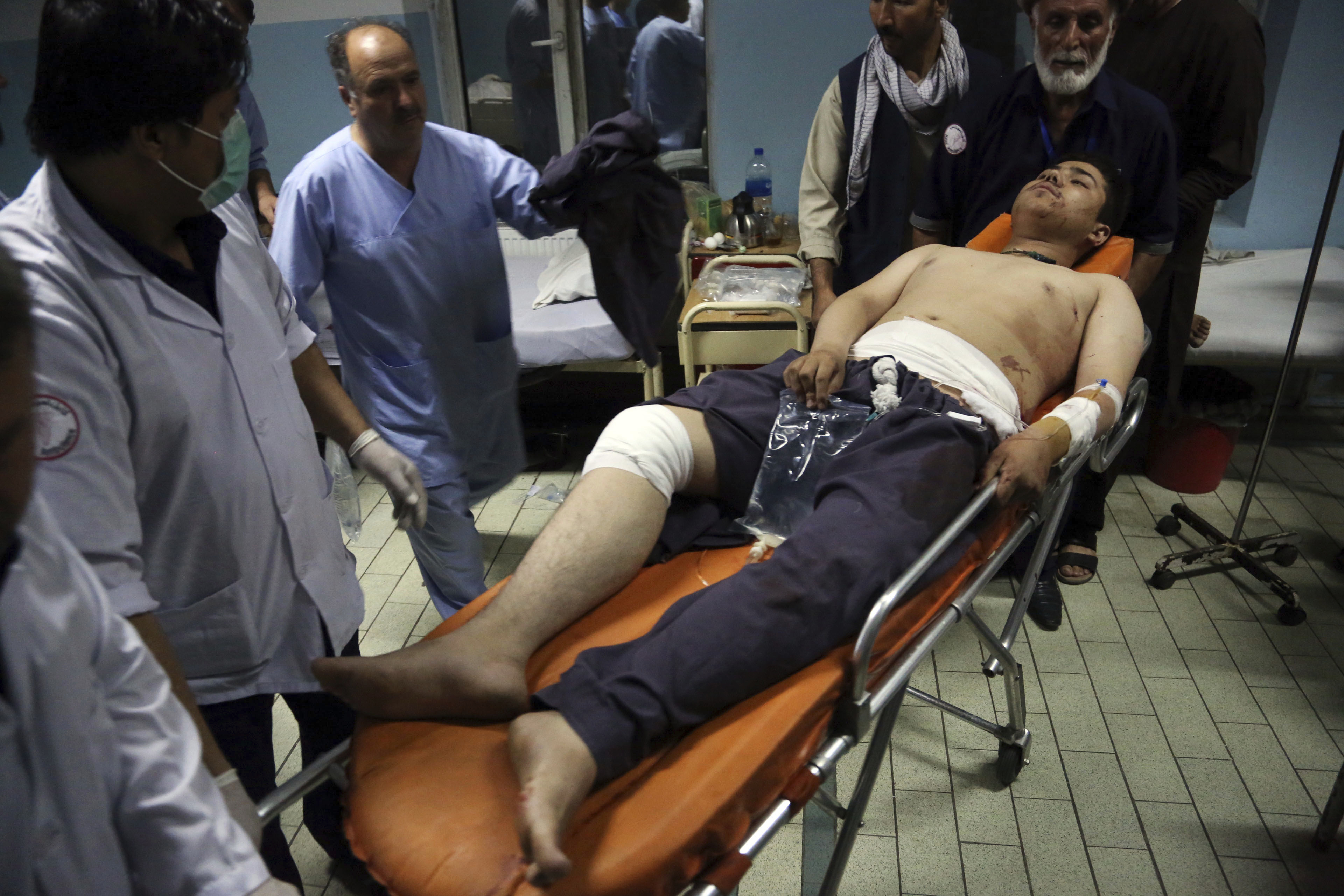 An injured man is brought in to a hospital following a deadly attack in Kabul, Afghanistan, Sept. 5, 2018.