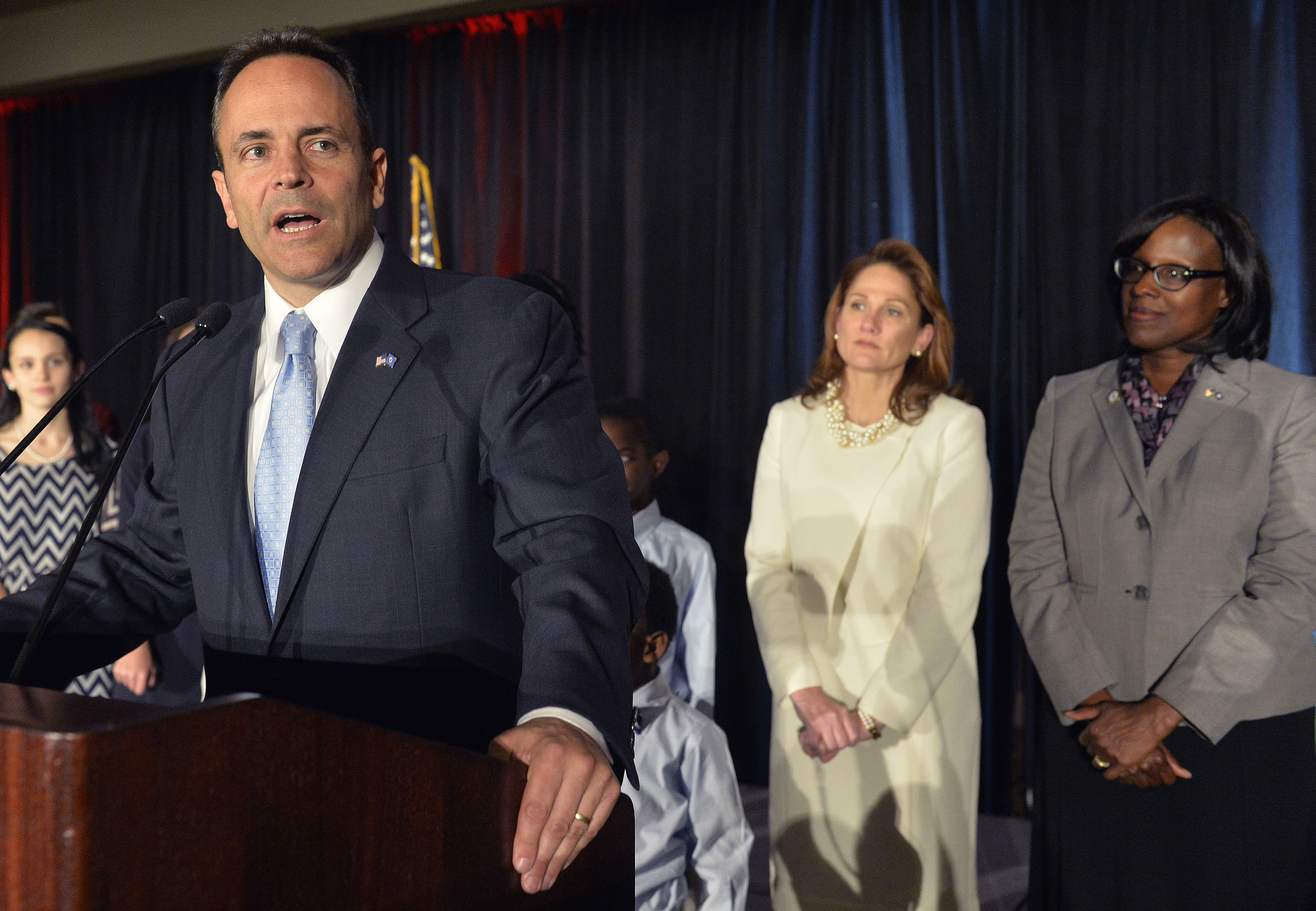 With his wife Glenna Bevin, center, and Lieutenant Governor-elect Jenean Hampton, right, looking on, Kentucky Republican Governor-elect Matt Bevin, speaks to his supporters at the Republican Party victory celebration, Tuesday, Nov. 3, 2015, in Louisv...
