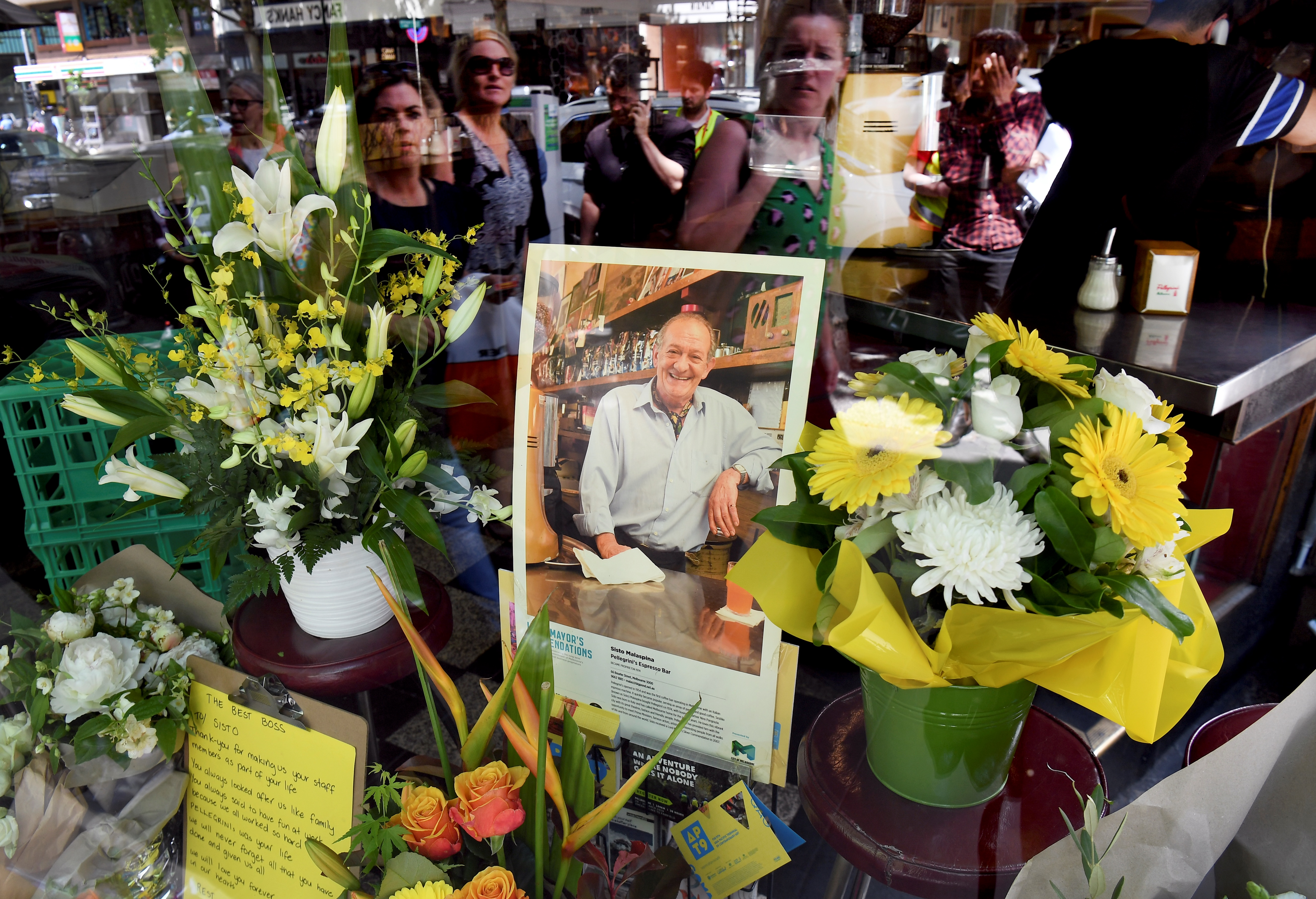 People pay their respects for Sisto Malaspina, who was killed Nov. 9, 2018, in a stabbing attack in Melbourne. Malaspina, 74, an icon of Melbourne's thriving culinary culture, was killed by Somali-born Australian Hassan Khalif Shire Ali.