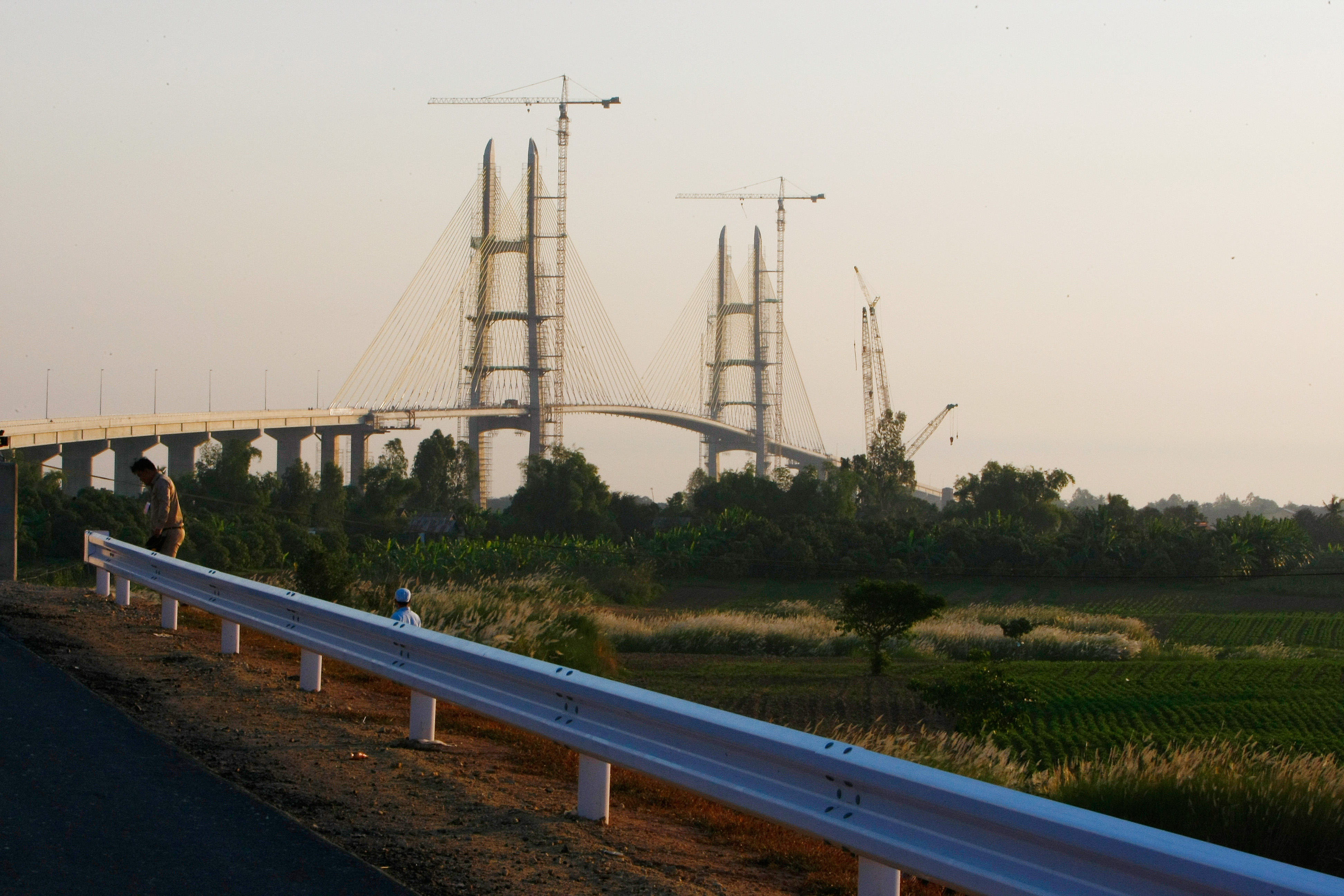 Work continues on Cambodia longest bridge before it is inaugurated by Hun Sen, Cambodian Prime Minister in Neak Loeung, southeast of Phnom Penh, Cambodia, Jan. 14, 2015.