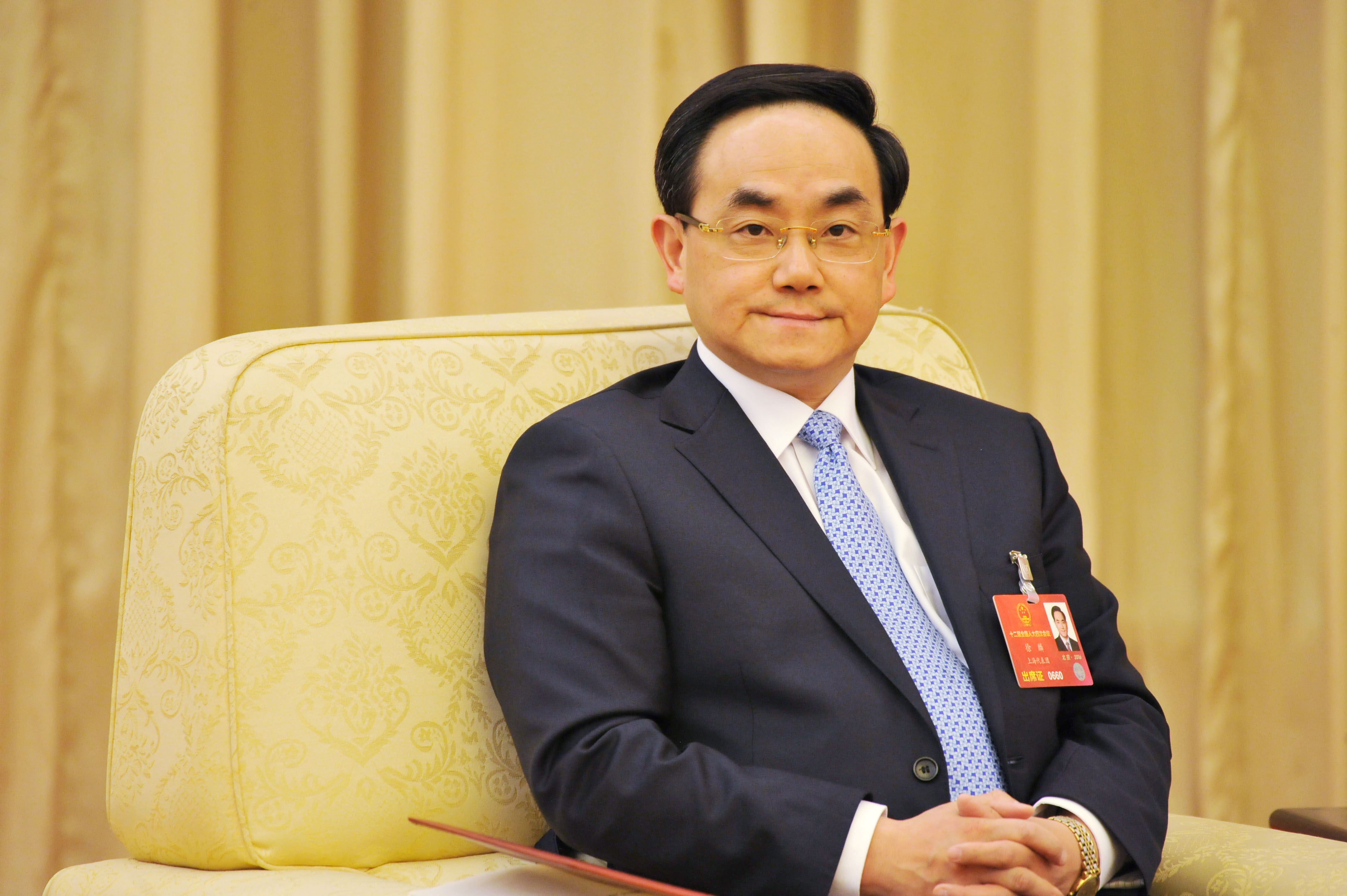 Xu Lin, deputy director of China's internet regulator, attends a Shanghai delegation group discussion at the National People's Congress (NPC) in Beijing, China, March 6, 2016.