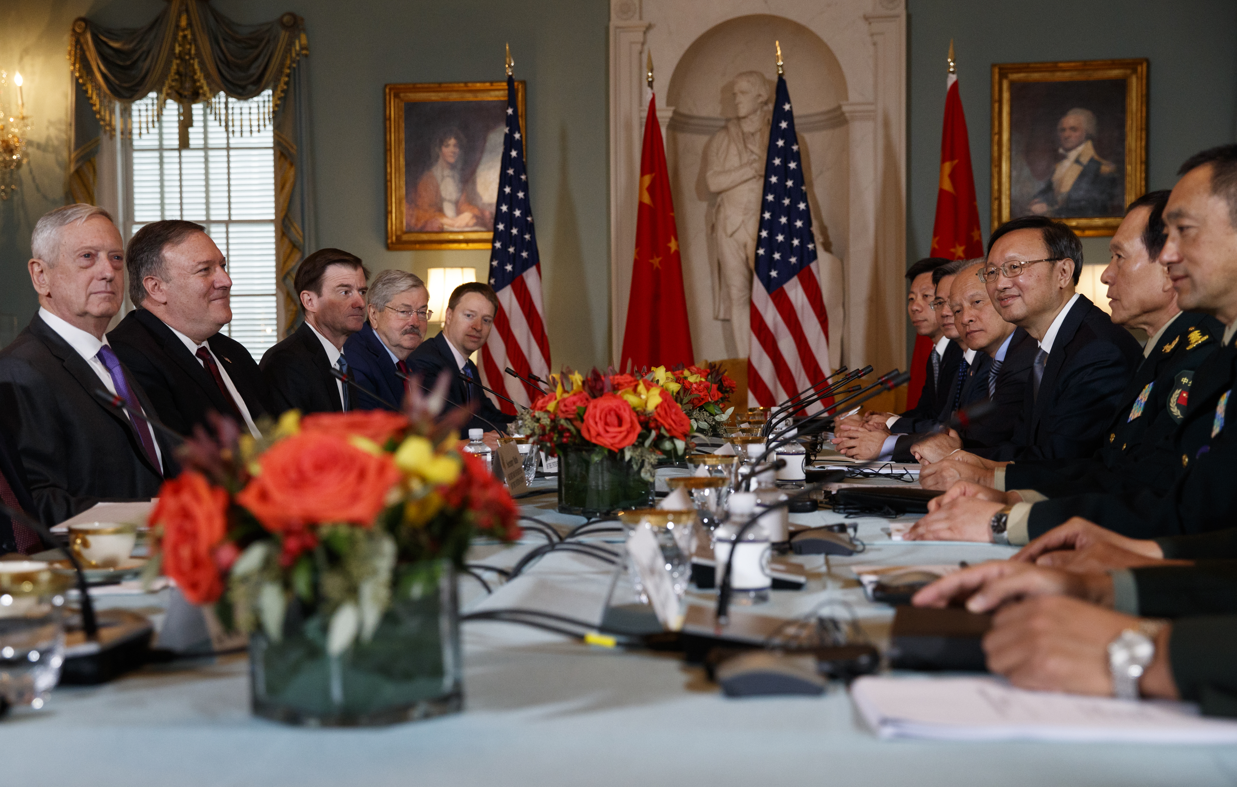 Secretary of Defense Jim Mattis, left, Secretary of State Mike Pompeo, second from left, Chinese Politburo member Yang Jiechi, third from right, and Chinese State Councilor and Defense Minister Gen. Wei Fenghe, second from right, meet at the State De...