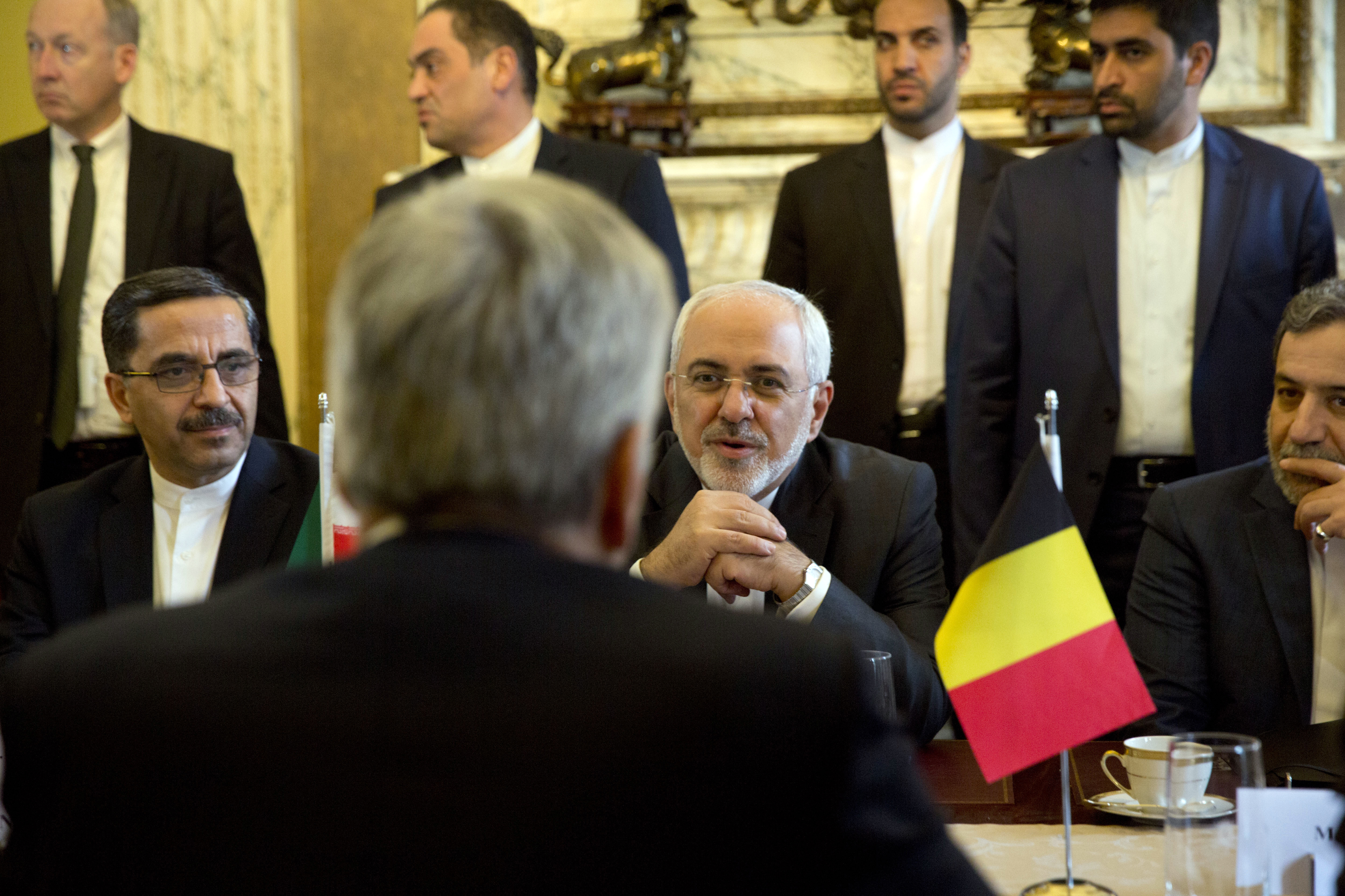 Iranian Foreign Minister Mohammad Javad Zarif, center right, speaks with Belgian Foreign Minister Didier Reynders during a meeting at the Egmont Palace in Brussels, Jan. 11, 2018. European Union foreign ministers held separate talks with their Irania...