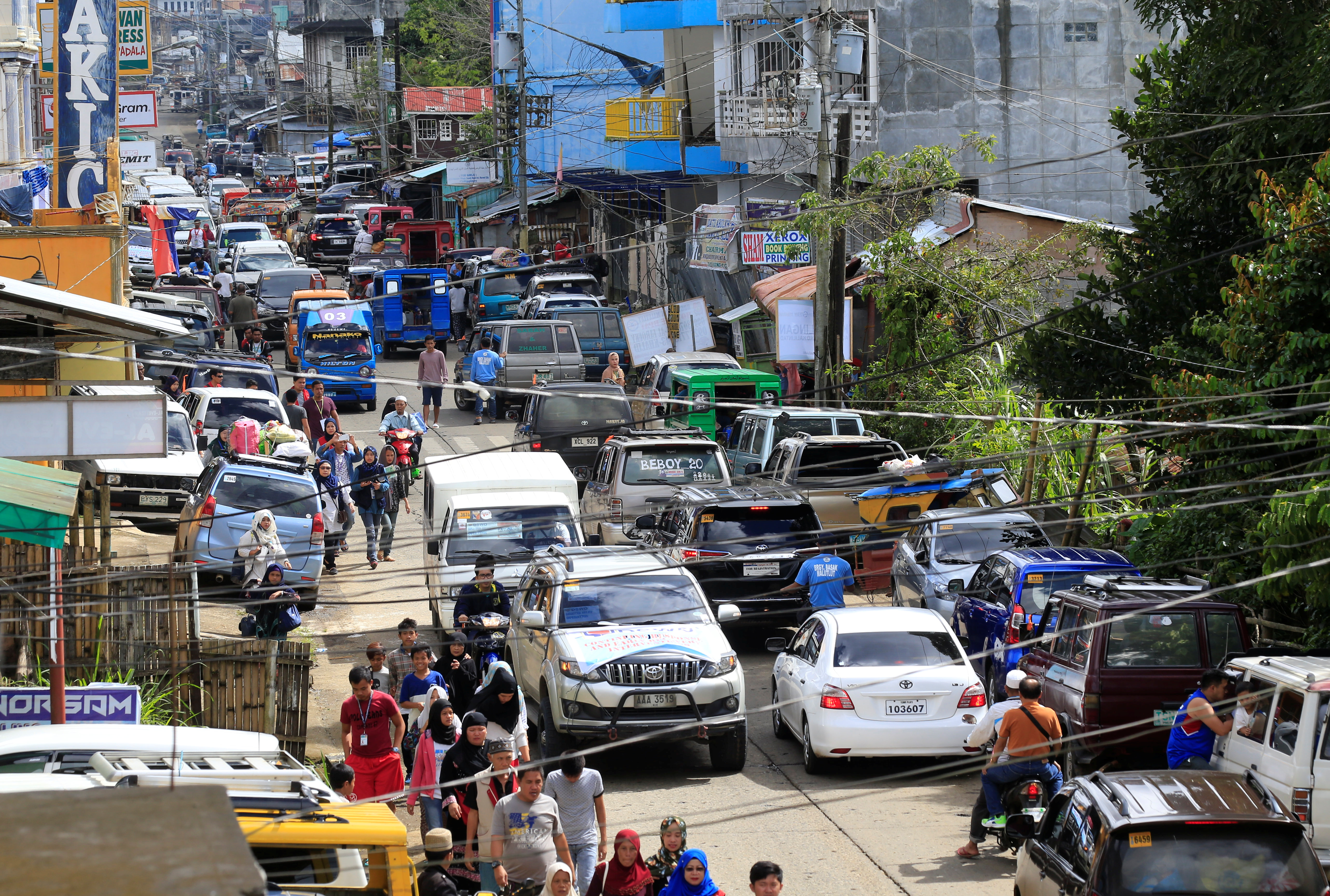 Residents who stayed at evacuation centers, because of the assault of government troops against pro-Islamic State militant groups, were allowed to return to their homes in Basak, Malutlut district in Marawi city, southern Philippines, Oct. 29, 2017. ...