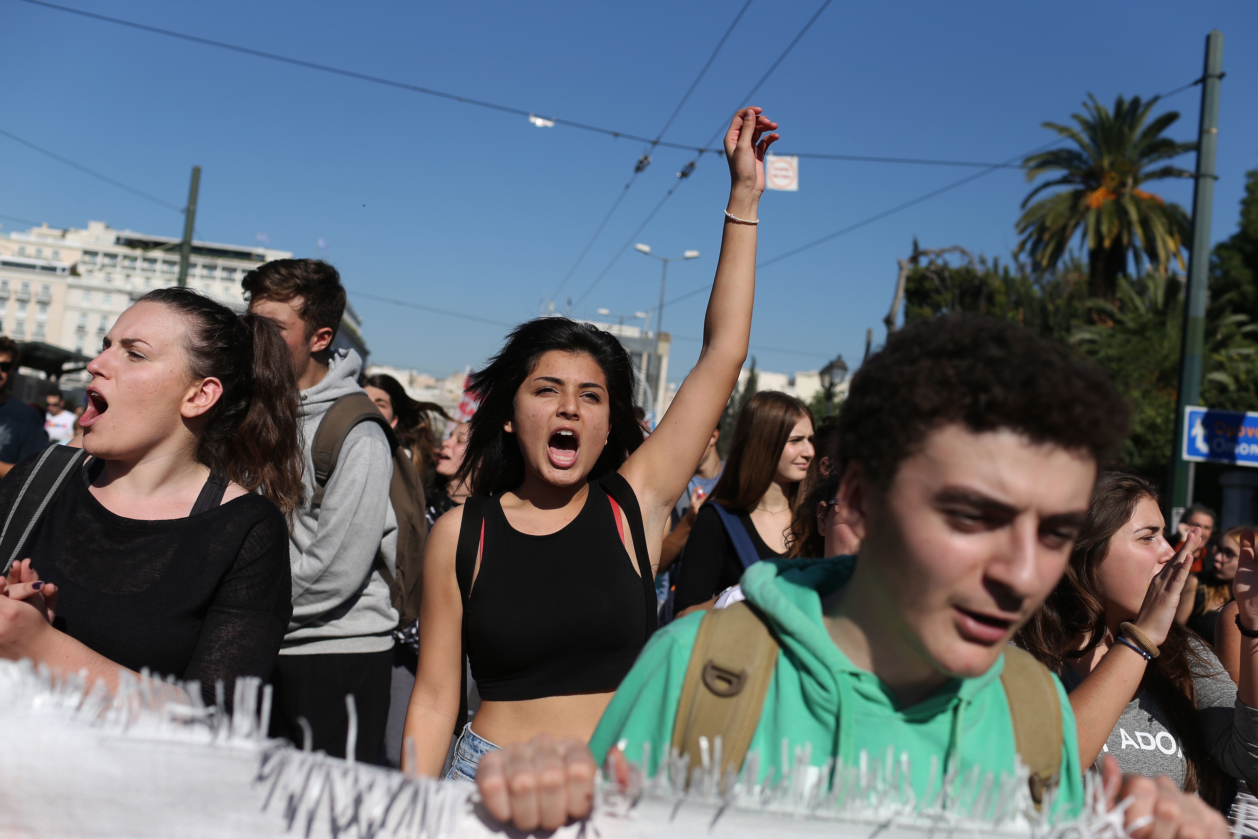 Students chant slogans as they protest during a 24-hour nationwide general strike Nov. 12, 2015, in Athens.