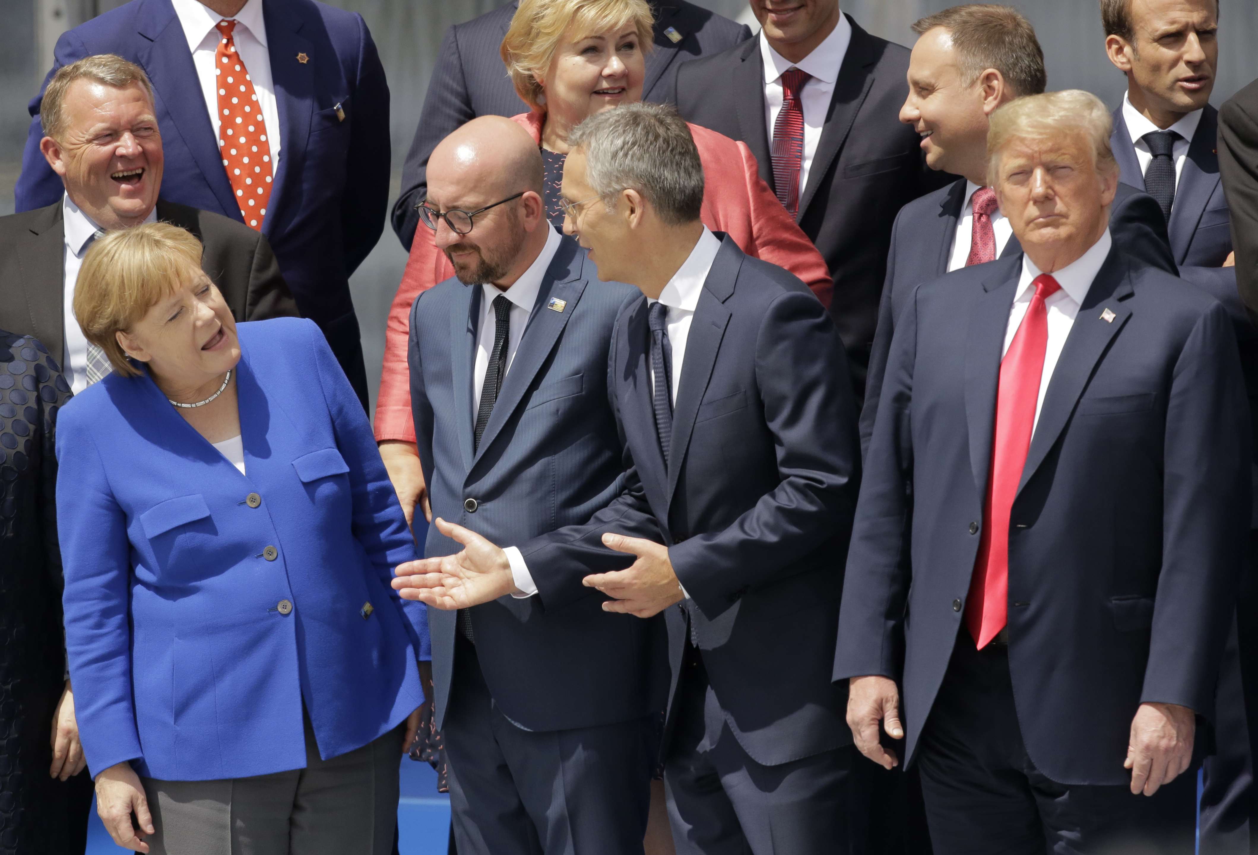 (L-R) German Chancellor Angela Merkel, Belgian Prime Minister Charles Michel, NATO Secretary-General Jens Stoltenberg and U.S. President Donald Trump, watch a fly-by during a summit of heads of state and government at NATO headquarters in Brussels, J...