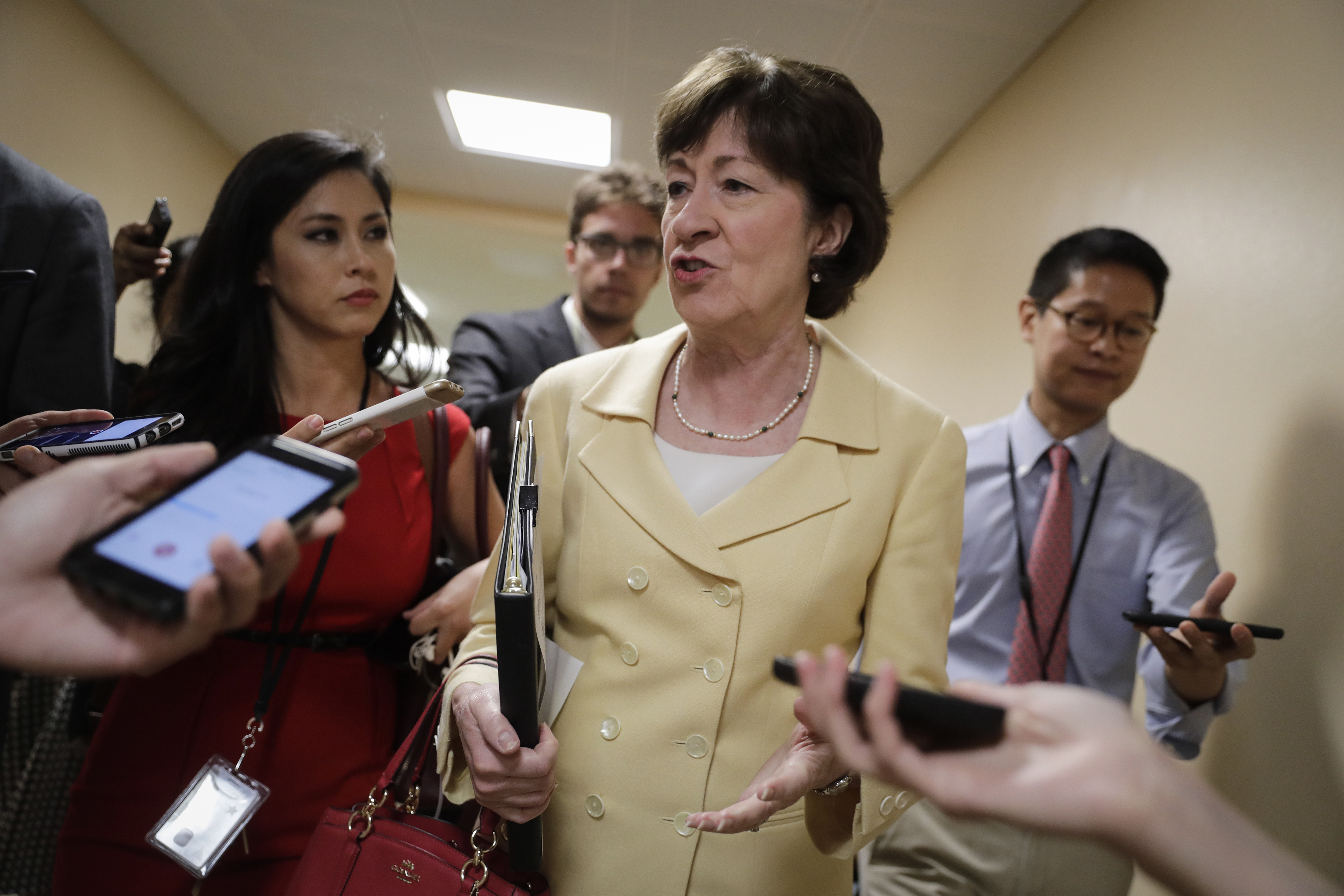 Sen. Susan Collins, R-Maine, a member of the Senate Select Committee on Intelligence, talks to reporters in a corridor at the Capitol in Washington, June 21, 2017.