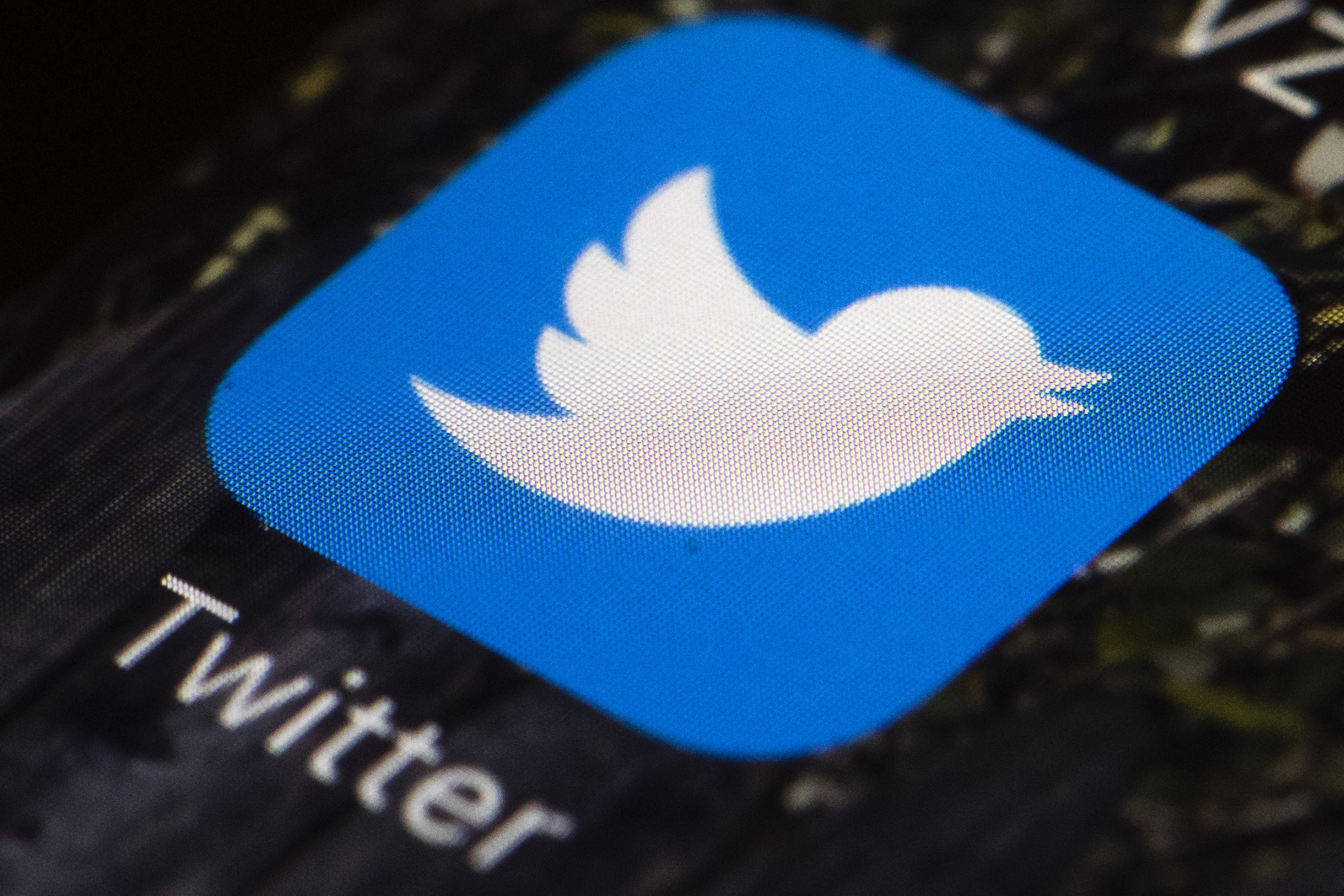 FILE - This April 26, 2017, file photo shows the Twitter app icon on a mobile phone in Philadelphia. According to a study released Jan. 24, 2019, a tiny fraction of Twitter users spread the vast majority of fake news in 2016, with conservatives and o...