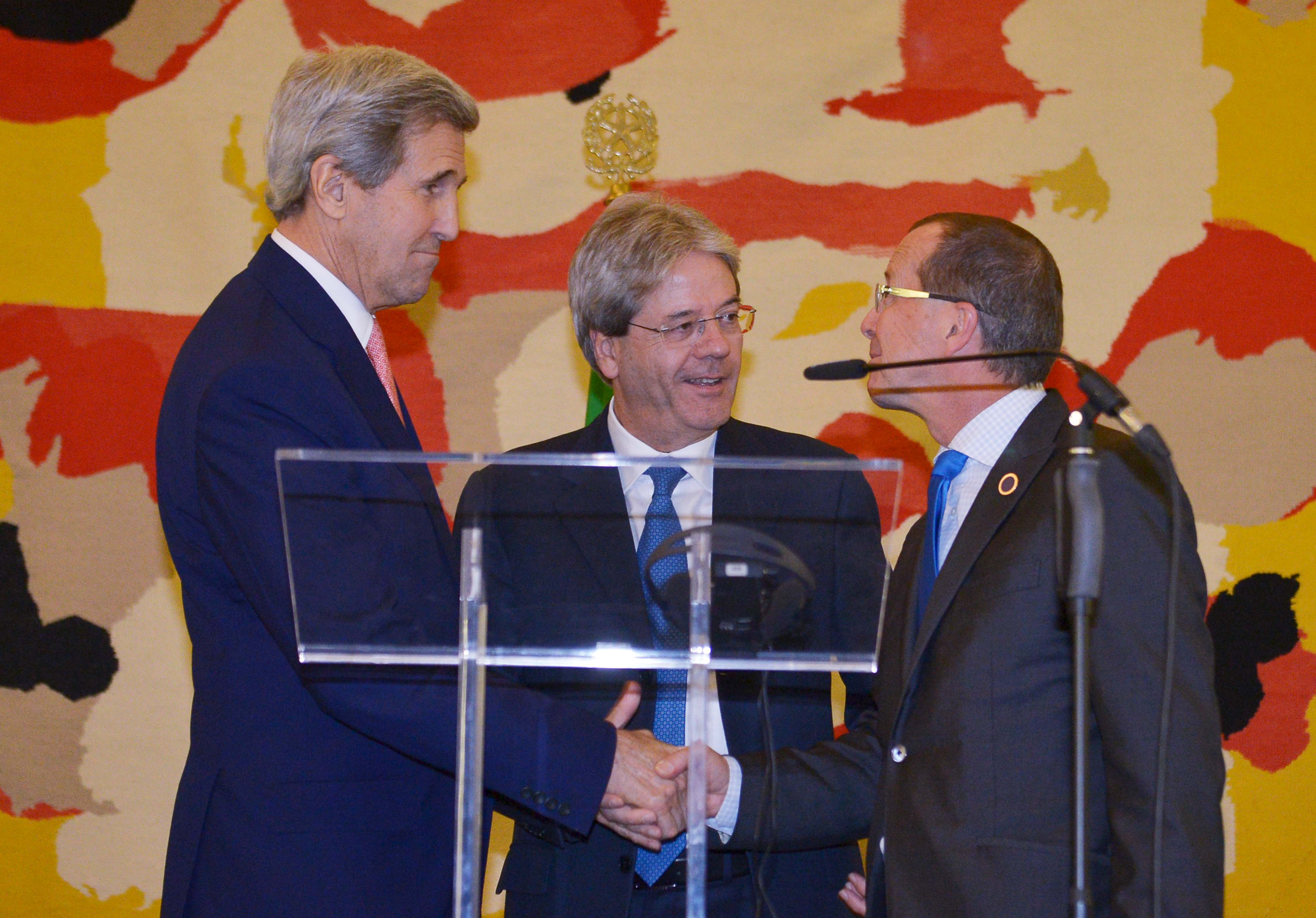 Italy's Foreign Minister Paolo Gentiloni (C), U.S. Secretary of State John Kerry (L) and UN special envoy for Libya Martin Kobler at a joint news conference following an international conference on Libya at the Ministry of Foreign Affairs in Rome, De...