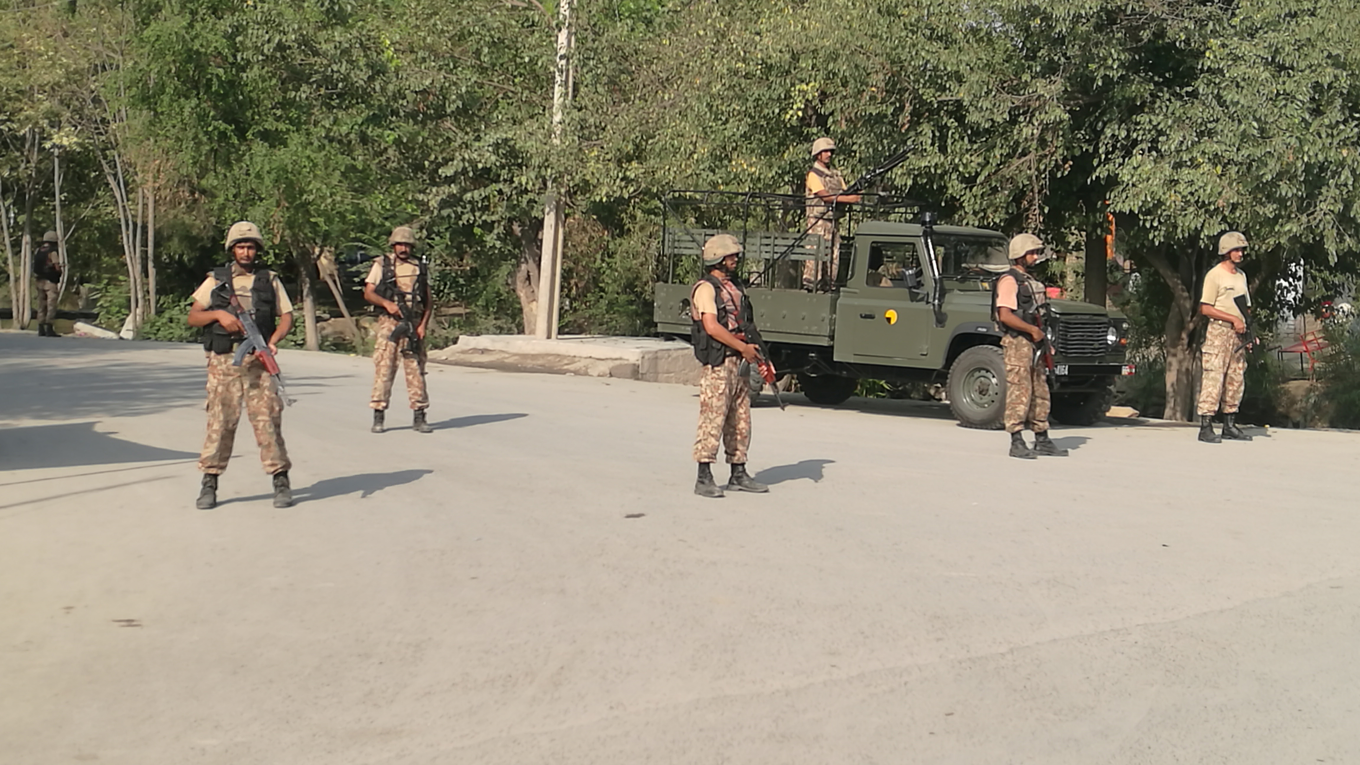 Army soldiers stand guard at street after suicide bombers attacked a Christian neighborhood in Khyber Agency near Peshawar, Pakistan, September 2, 2016.