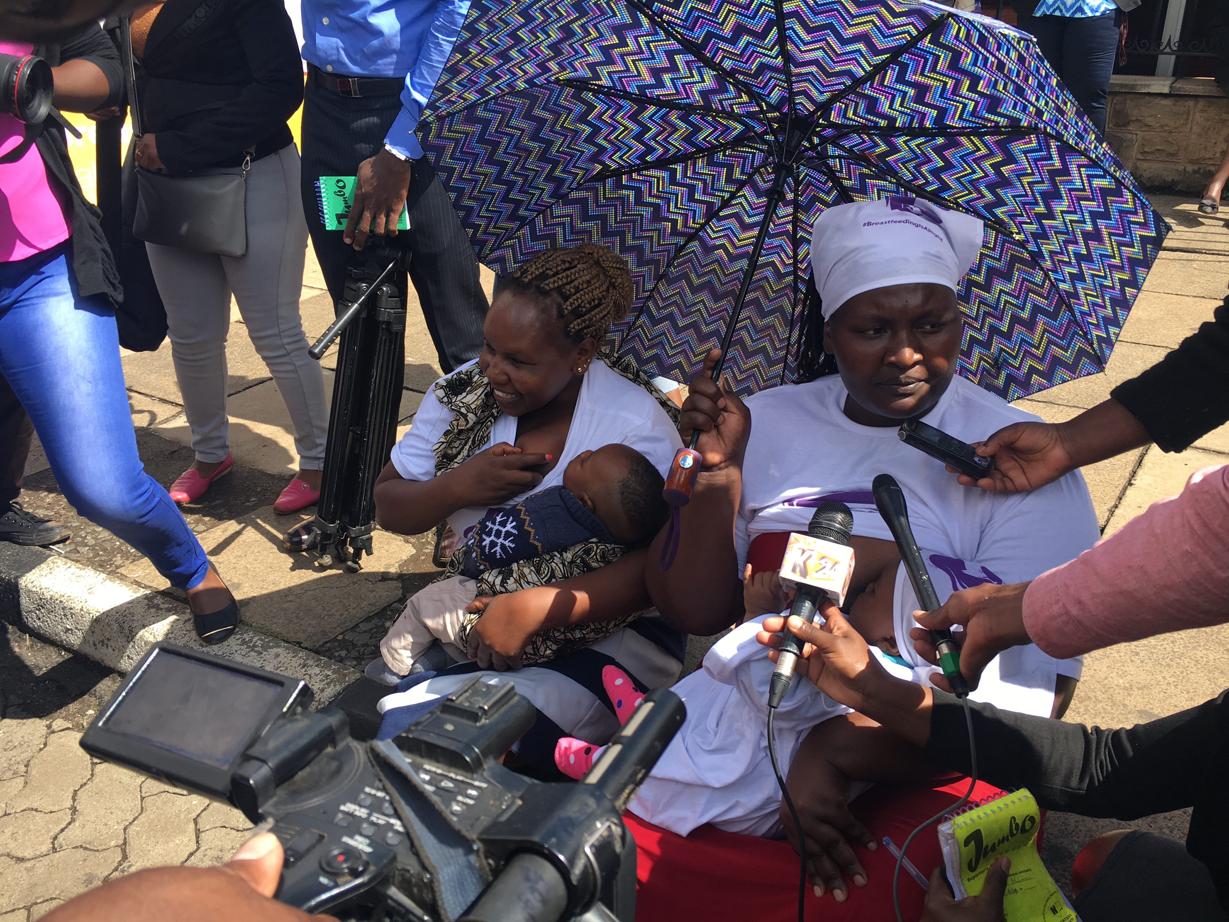 Mothers breastfeed there children outside parliament as they respond to questions from journalists in Nairobi, Kenya, May 15, 2018.