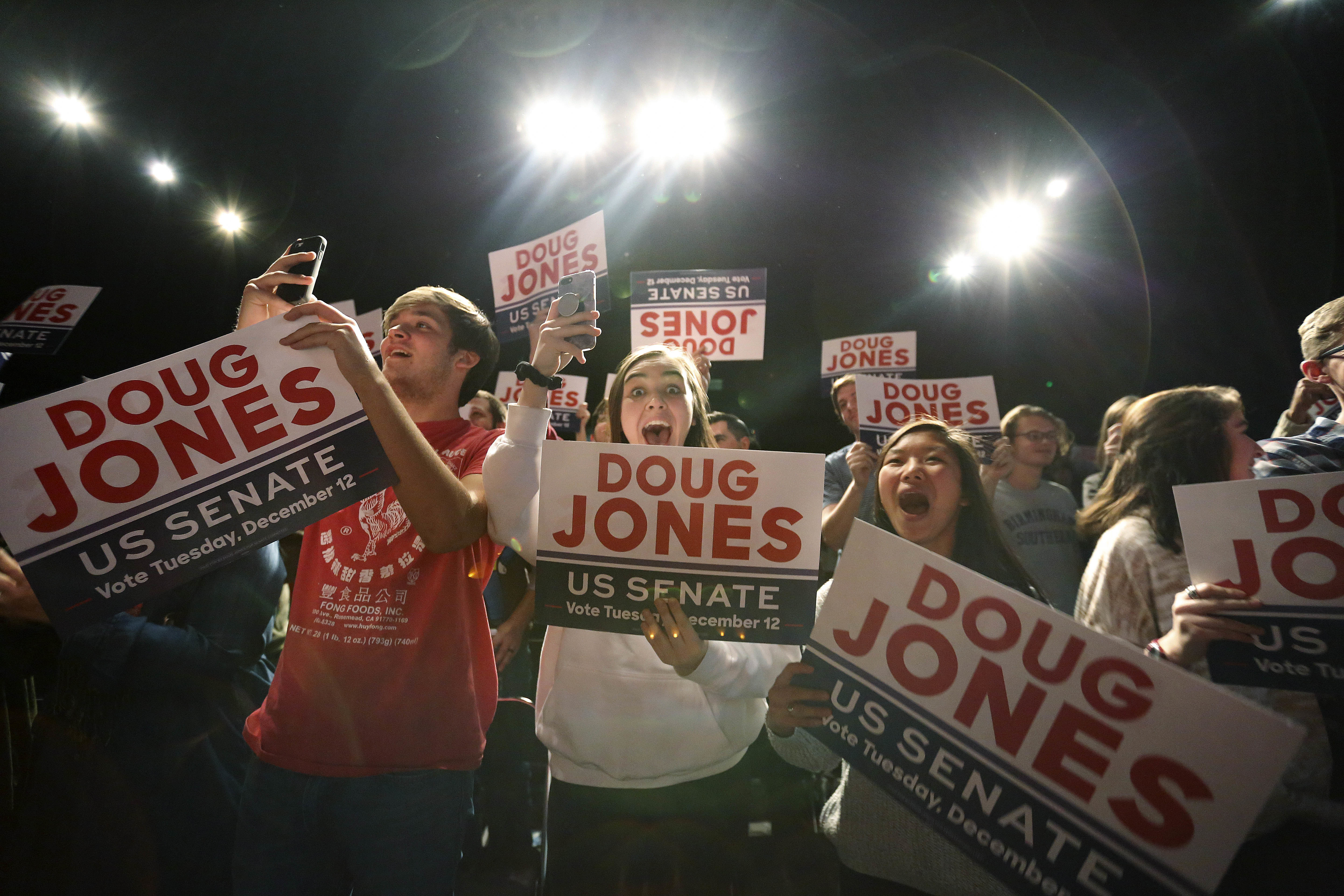"""Supporters of Democratic senatorial candidate Doug Jones cheer as he comes onstage before he speaks during a """"get out the vote rally,"""" Dec. 9, 2017, in Birmingham, Ala."""