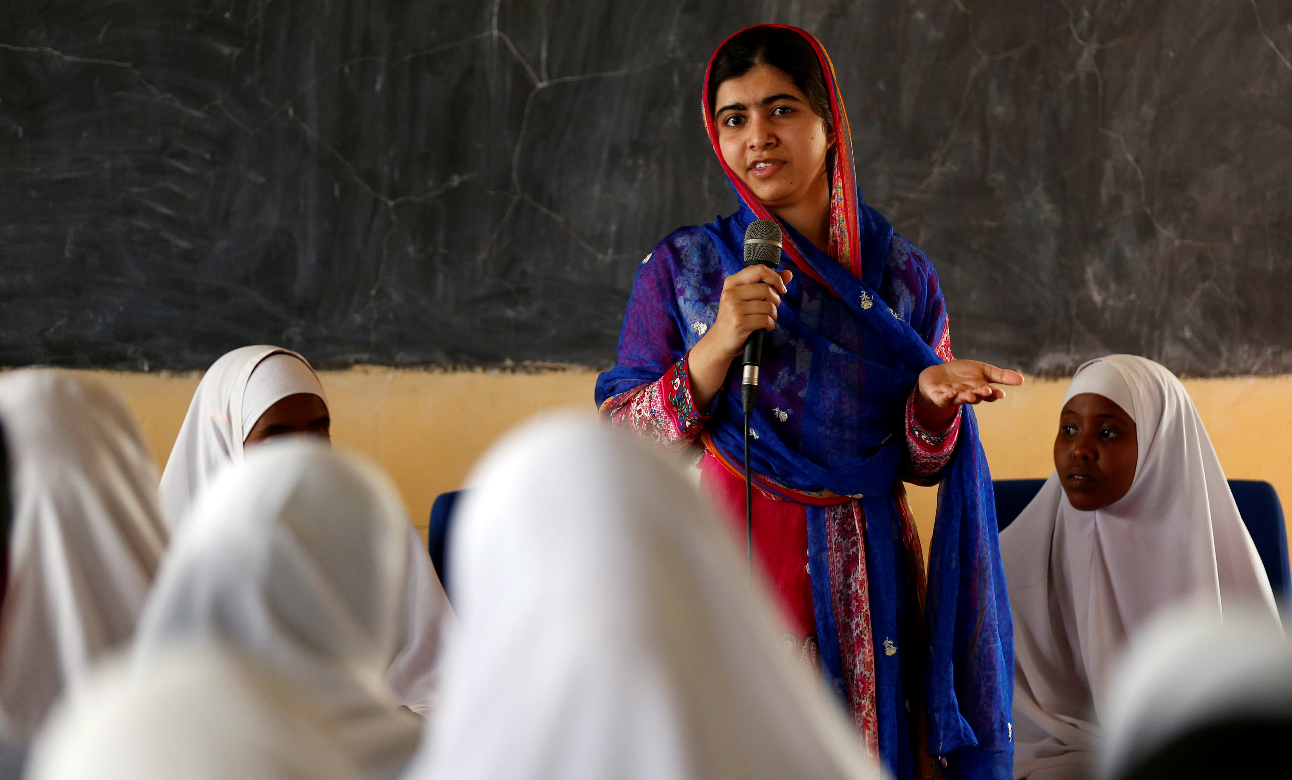 Pakistani Nobel Peace Prize laureate Malala Yousafzai addresses students at the Nasib Secondary School in Ifo2 area of Dadaab refugee camp during celebrations to mark her 19th birthday near the Kenya-Somalia border, July 12, 2016.