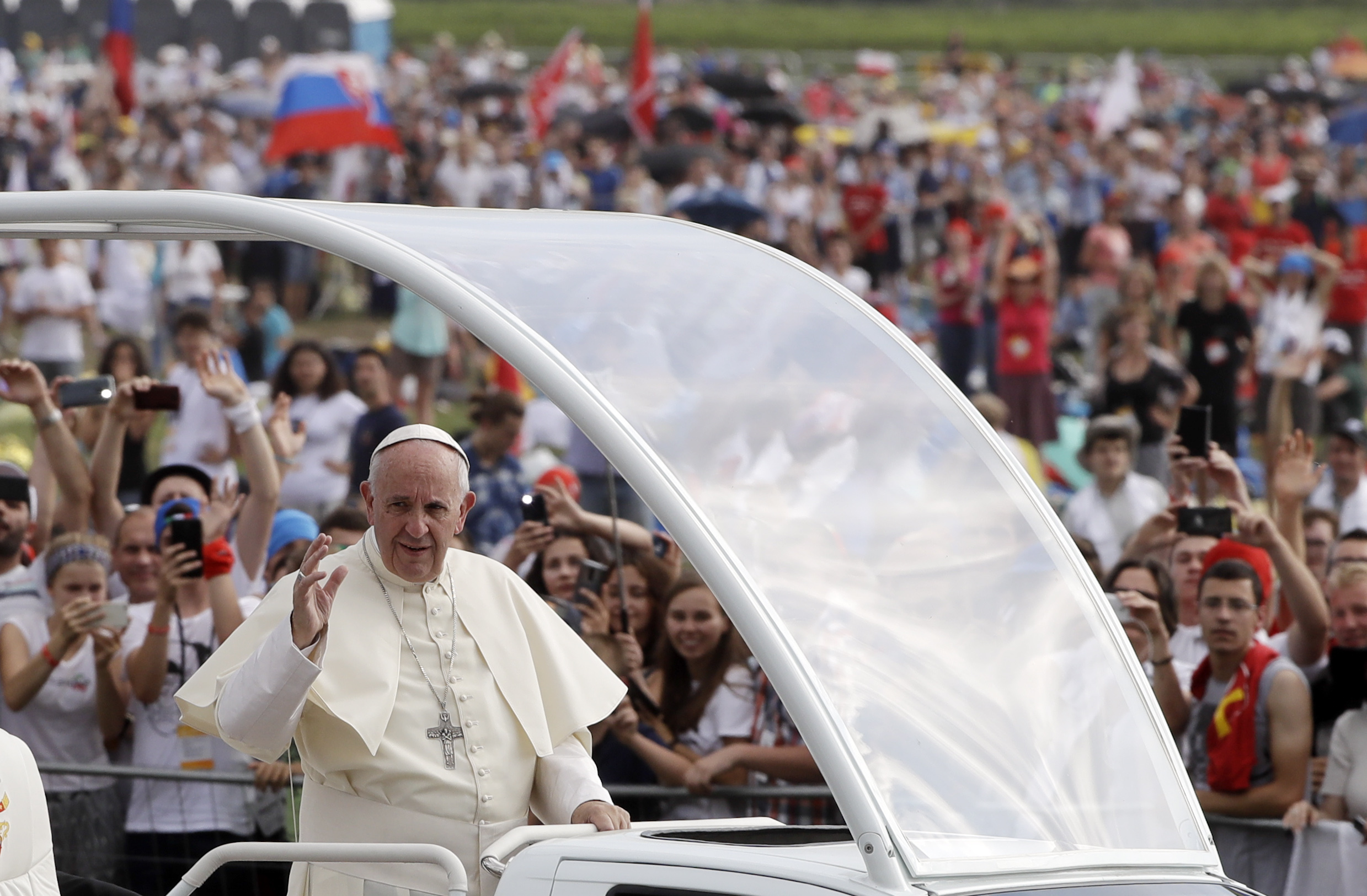 Pope Francis followed by a security guard arrives to celebrate a mass at conclusion of the World Youth Day inKrakow, Poland, Sunday, July 31, 2016.