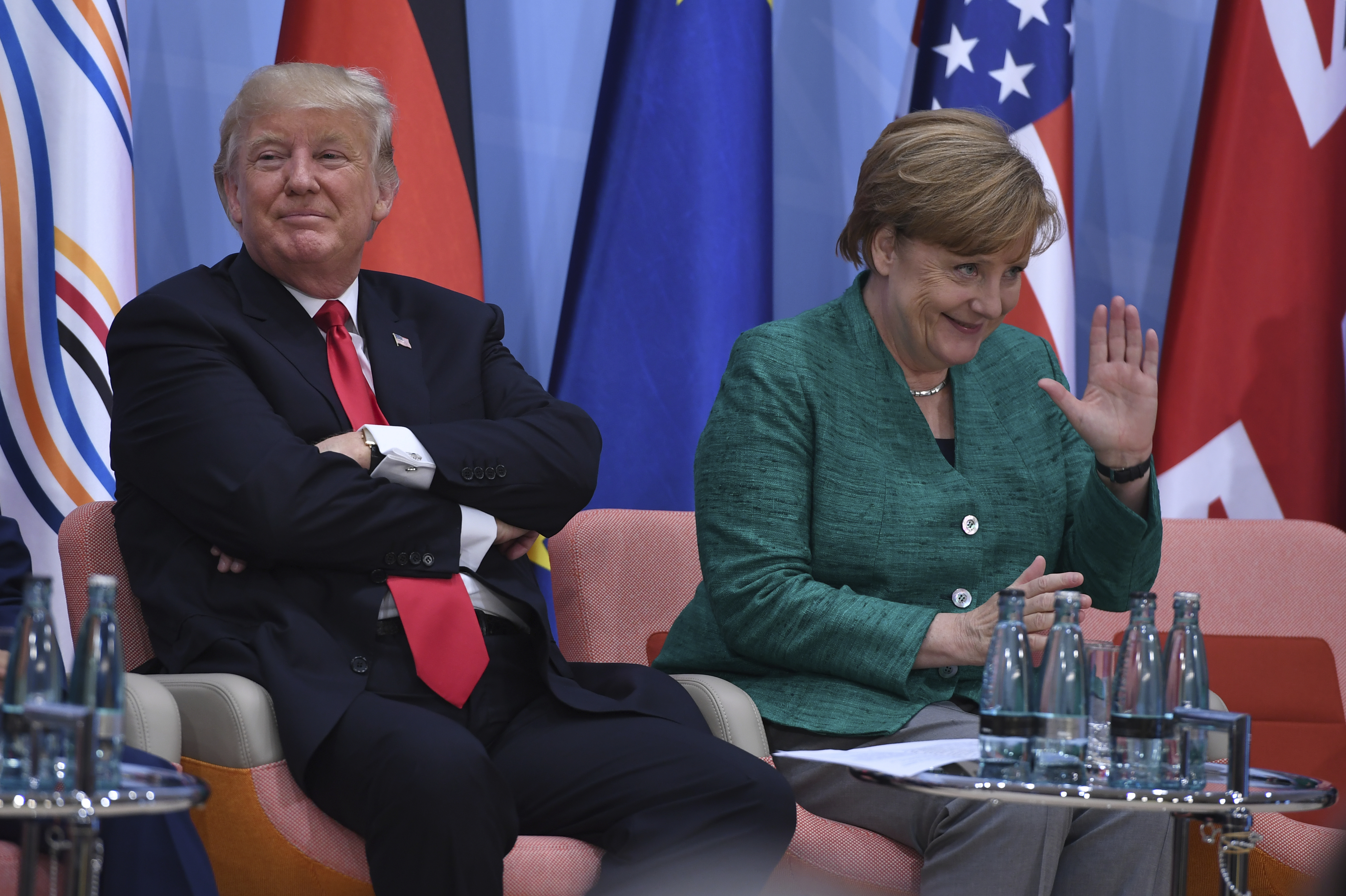U.S. President Donald Trump, left, and German Chancellor Angela Merkel are seen at the panel discussion of the Women's Entrepreneur Finance event on the second day of the G-20 summit in Hamburg, Germany, July 8, 2017.