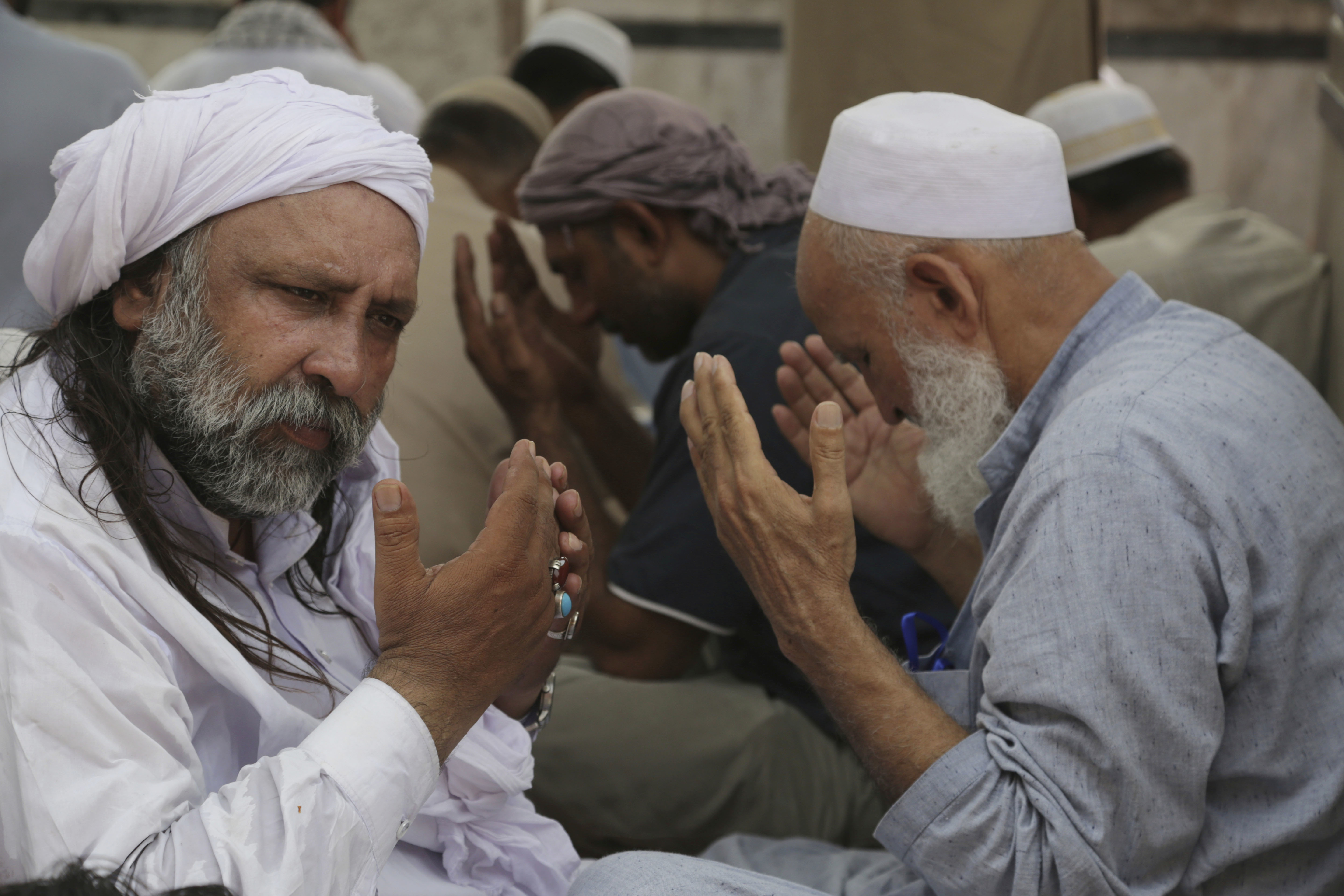 Pakistani Muslims take part in Friday prayers at Data Darbar Mosque during the holy fasting month of Ramadan, in Lahore, Pakistan, on June 16, 2017.