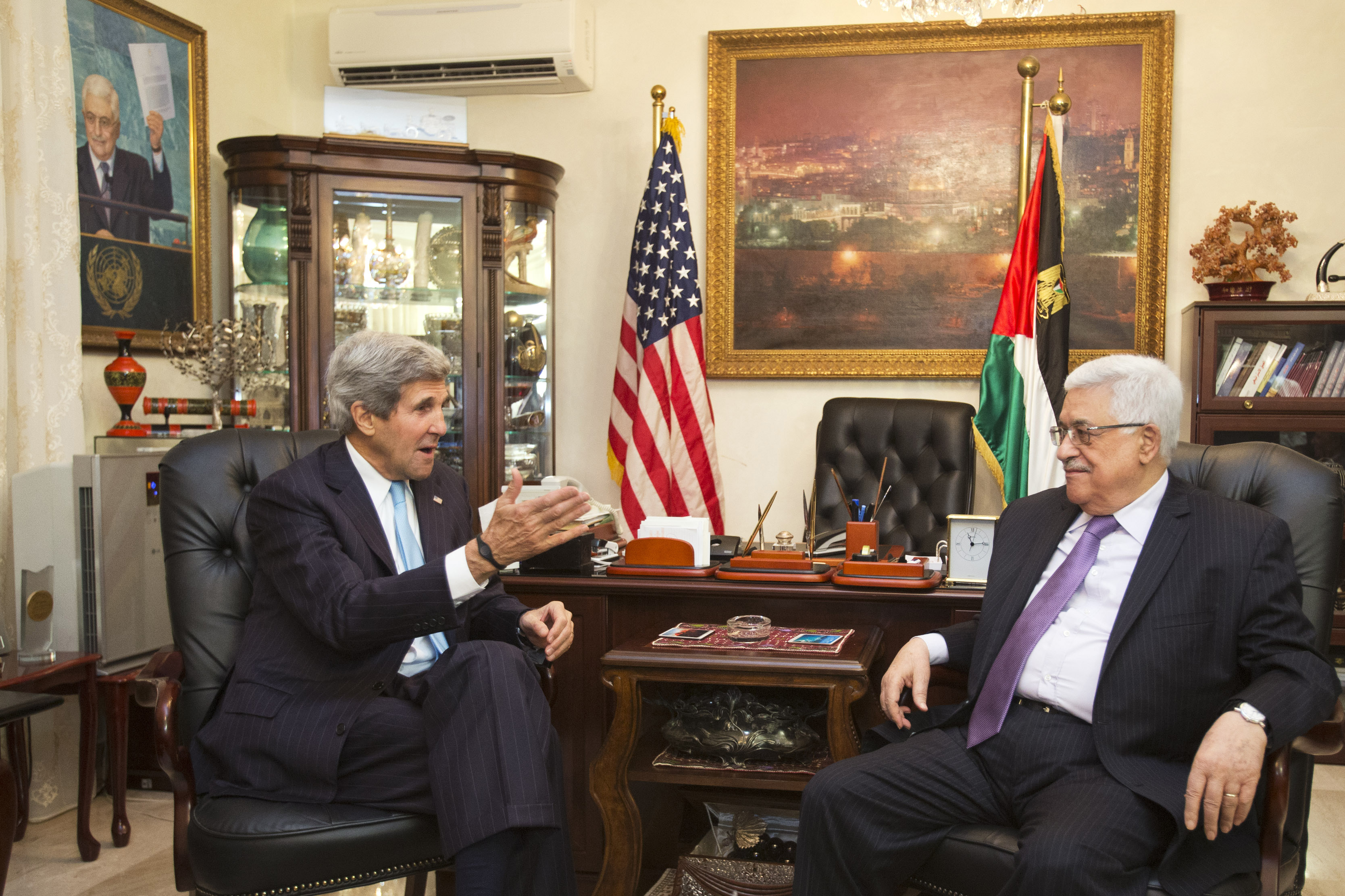 U.S. Secretary of State John Kerry, left, meets with Palestinian President Mahmoud Abbas in Amman, Jordan on Saturday, June 29, 2013, after shuttling to Jordan from Jerusalem in the morning.