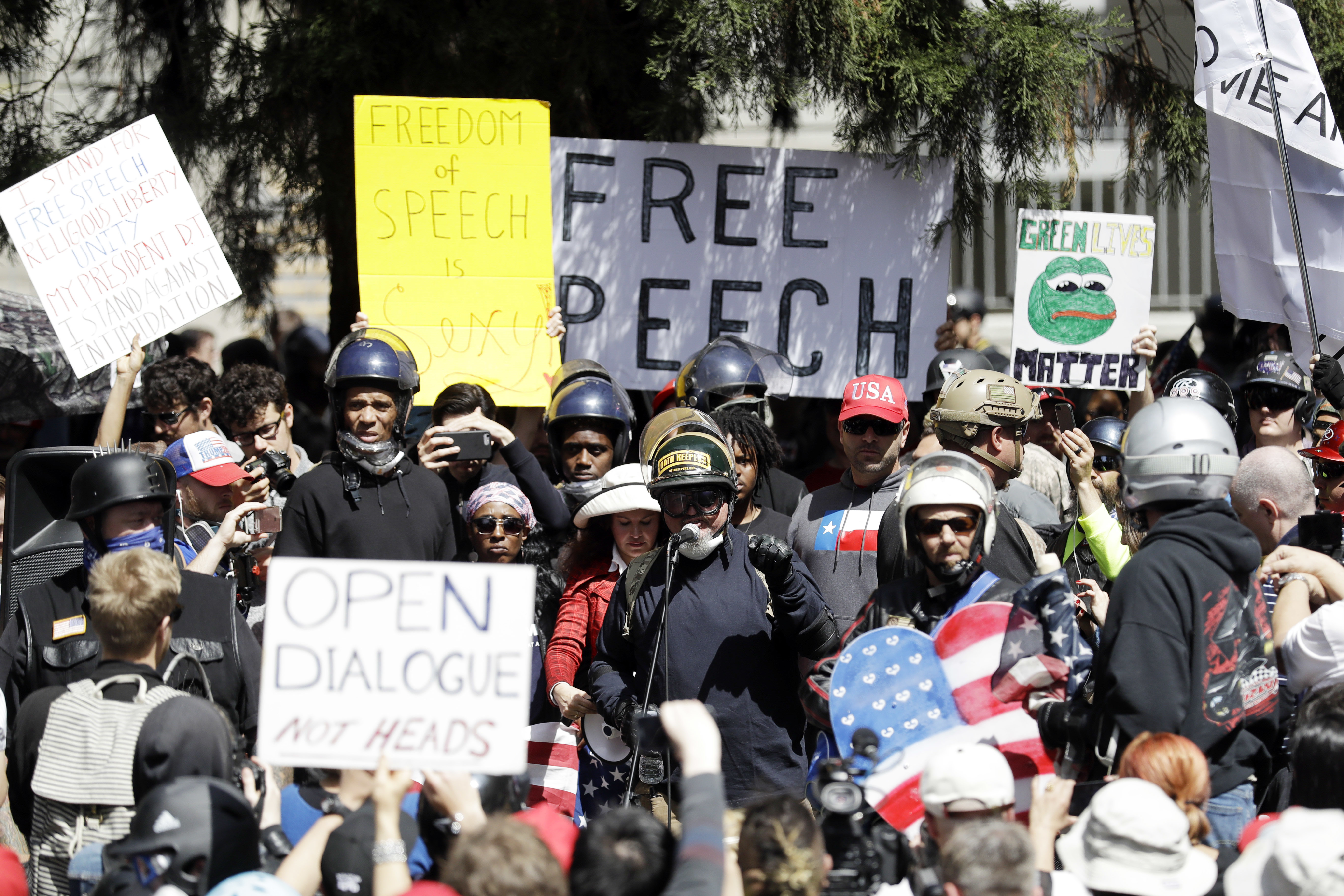 A crowd gathers around speakers during a rally for free speech April 27, 2017, in Berkeley, Calif. Demonstrators gathered near the University of California, Berkeley campus amid a strong police presence and rallied to show support for free speech and...