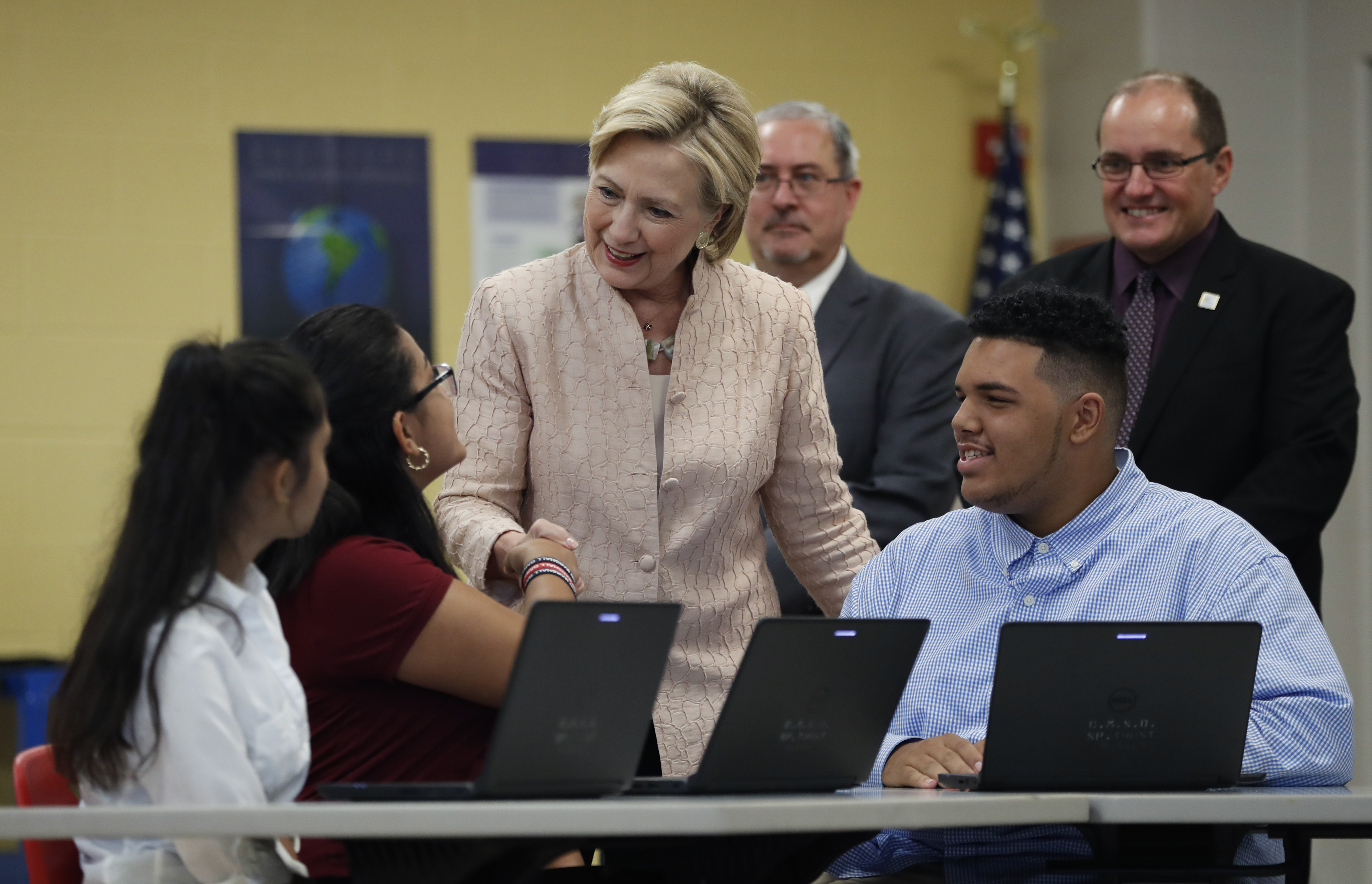 Democratic presidential candidate Hillary Clinton talks with students as she tours classrooms at John Marshall High School in Cleveland, Aug. 17, 2016, before participating in a campaign event.