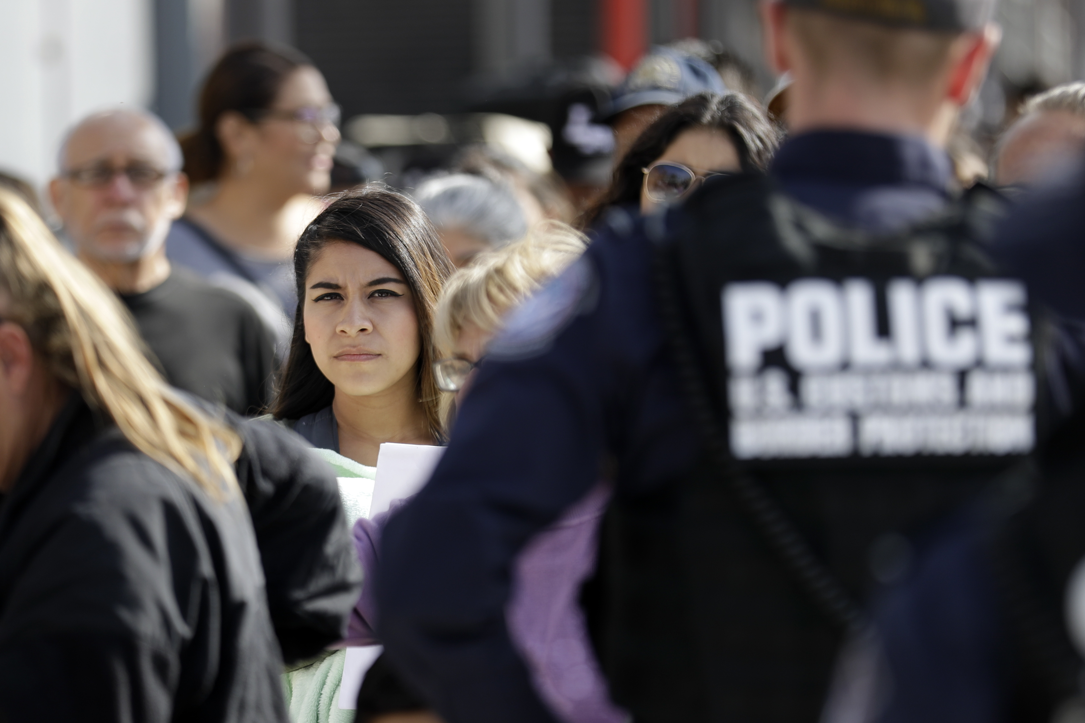 In this Nov. 19, 2018, file photo, people line up to cross into the United States from Tijuana, Mexico, at the San Ysidro port of entry in San Diego.