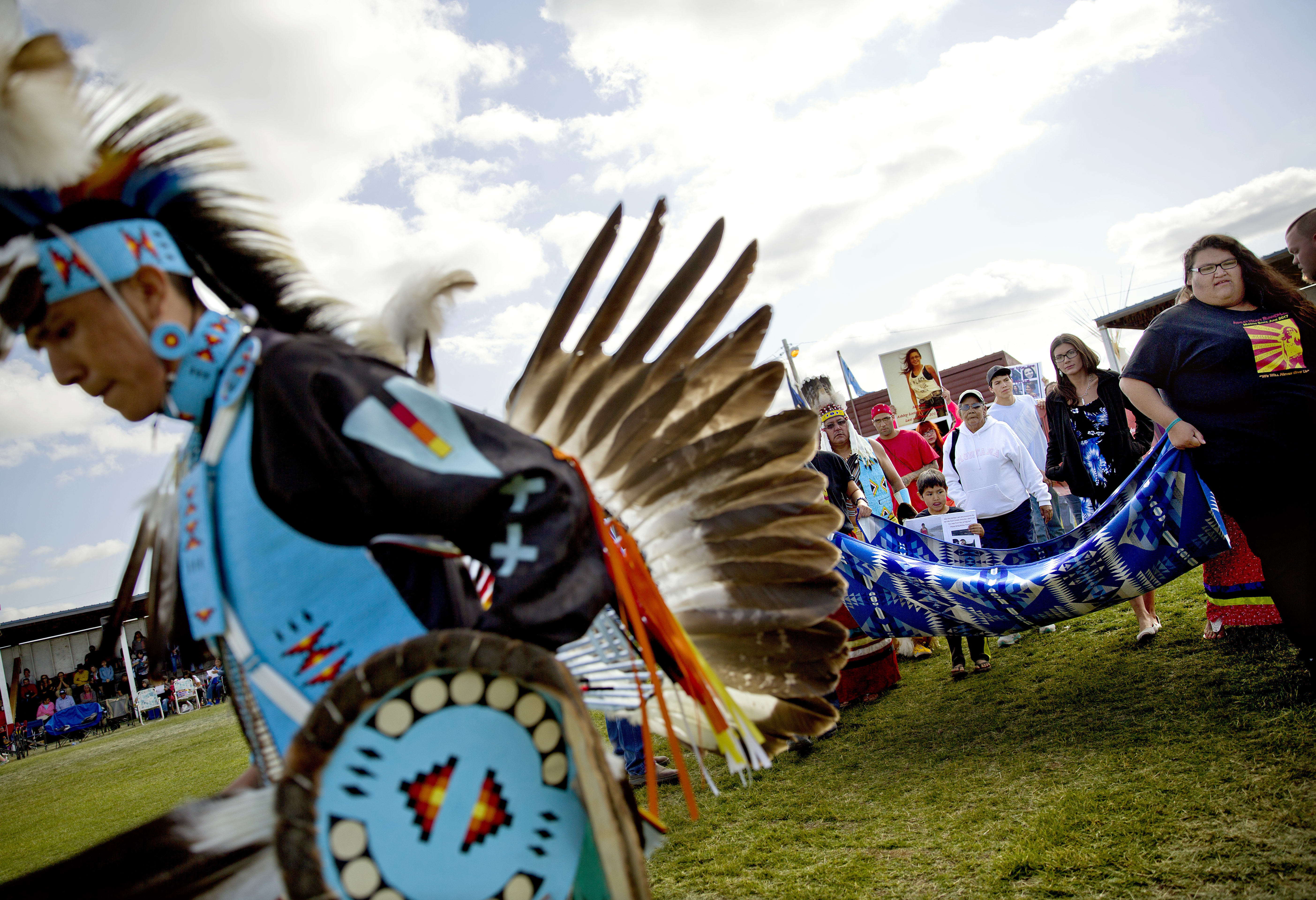 Friends and family members of Ashley HeavyRunner Loring hold a traditional blanket dance before the crowd at the North American Indian Days celebration to raise awareness and funds for her search on the Blackfeet Indian Reservation in Browning, Mont....