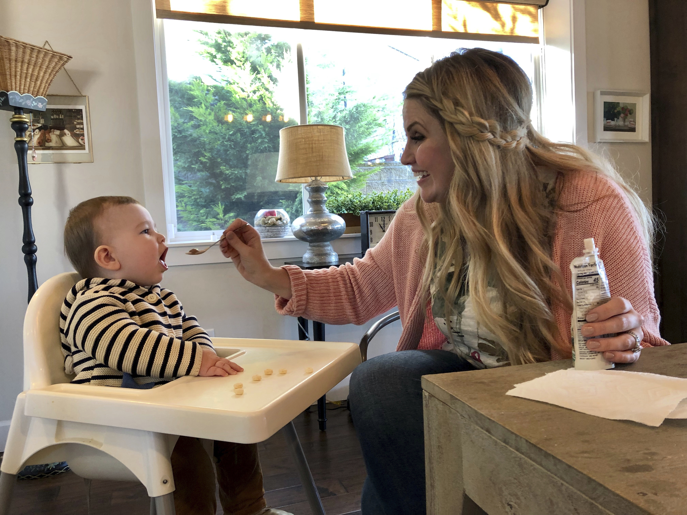 Jocelyn Smith cares for her 11-month-old son, Mason at their home in Camas, Wash., Jan. 30, 2019. Smith has been afraid to take Mason out of the house during a measles outbreak in southwest Washington because he is too young to receive the measles va...