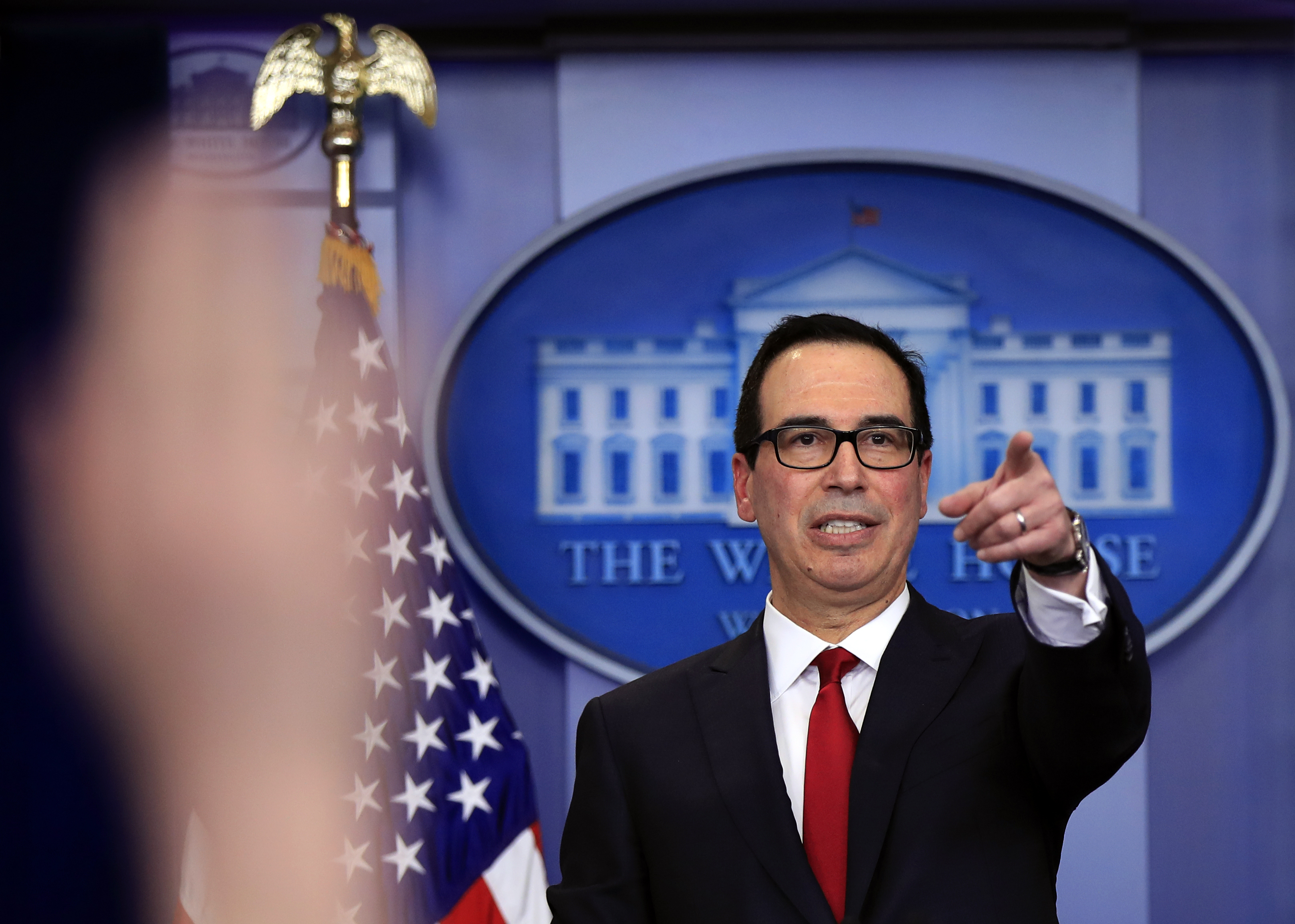 Treasury Secretary Steven Mnuchin, gestures during a White House daily press briefing in the Brady press briefing room at the White House, in Washington, Jan. 11, 2018.