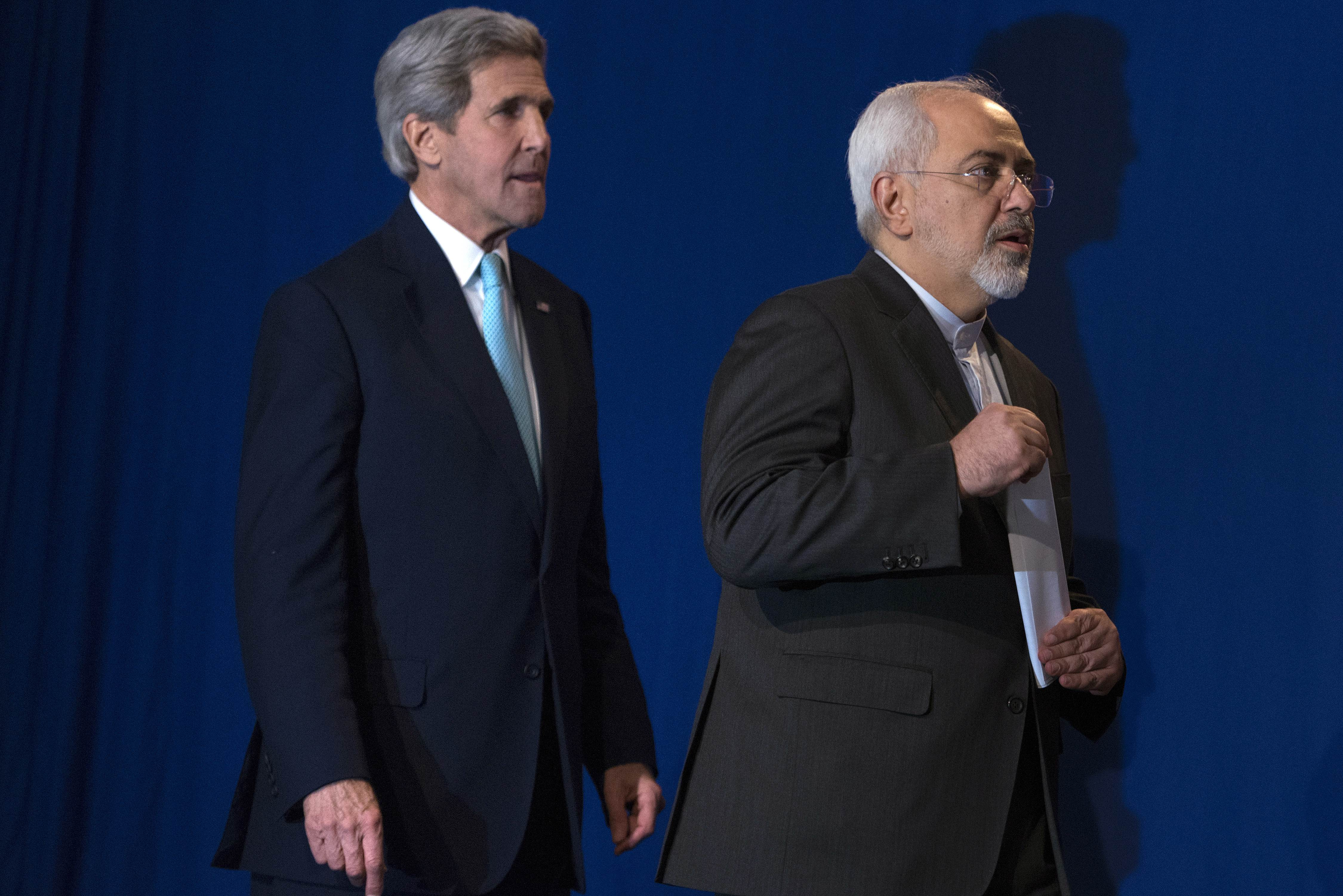 US Secretary of State John Kerry, left, and Iranian Foreign Minister Javad Zarif arrive to deliver a statement, at the Swiss Federal Institute of Technology, or Ecole Polytechnique Federale De Lausanne,  in Lausanne, Switzerland, Thursday, April 2, 2