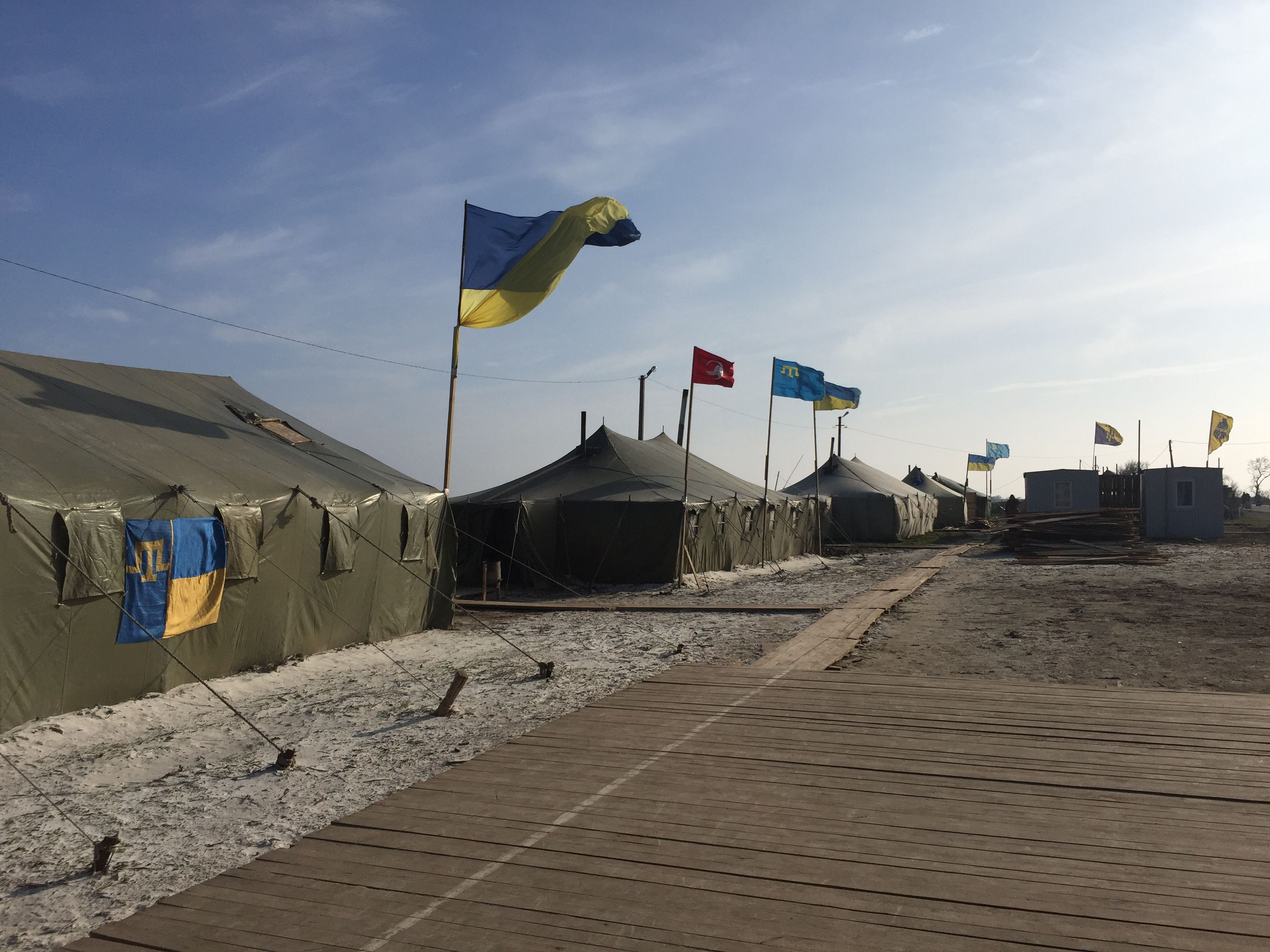 Tatars have organized a battalion and set up a camp near the new, unrecognized border between Ukraine and Russian-ruled Crimea. (L. Ramirez/VOA)