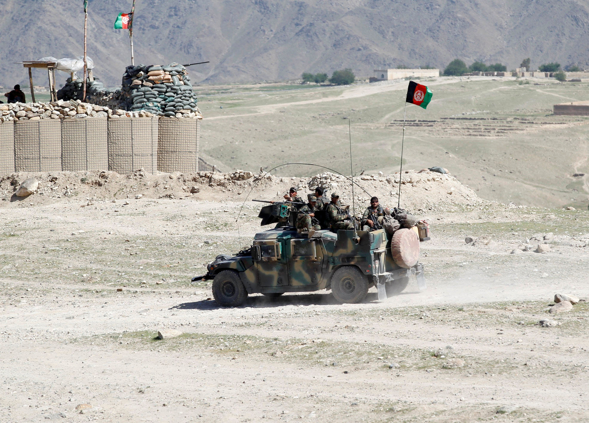 Afghan special forces patrol in Pandola village near the site of a U.S. bombing in the Achin district of Nangarhar province in eastern Afghanistan April 14, 2017.
