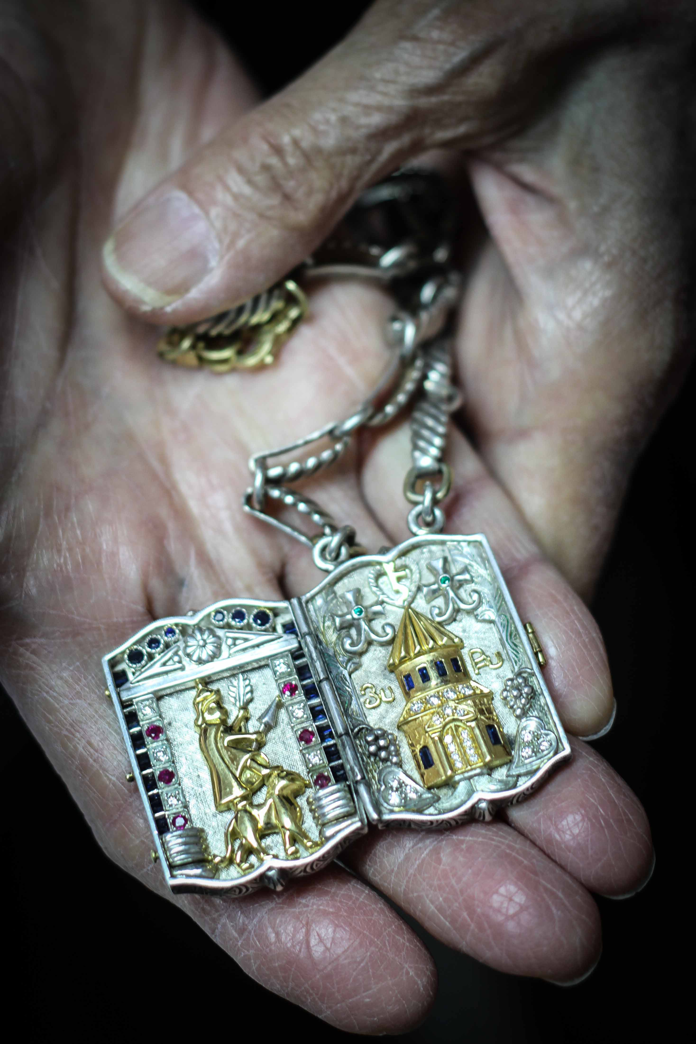Master jeweler Hrayr Dserounian shows one of the recent pieces he has crafted, in Beirut, Lebanon, April 1, 2016. The iconography reflects Armenian history.