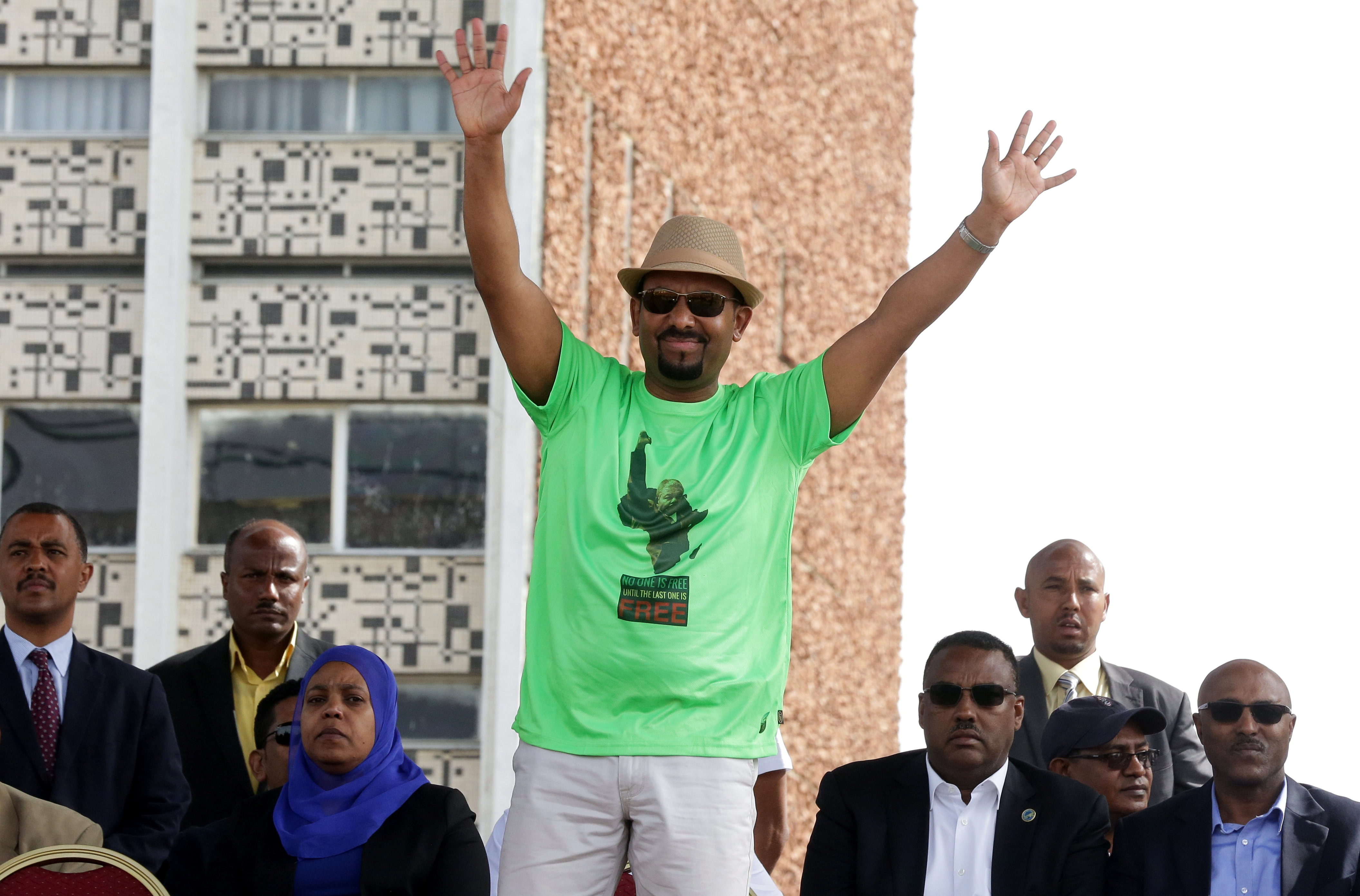Ethiopian Prime Minister Abiy Ahmed waves to supporters as he attends a rally in Addis Ababa, Ethiopia, June 23, 2018.
