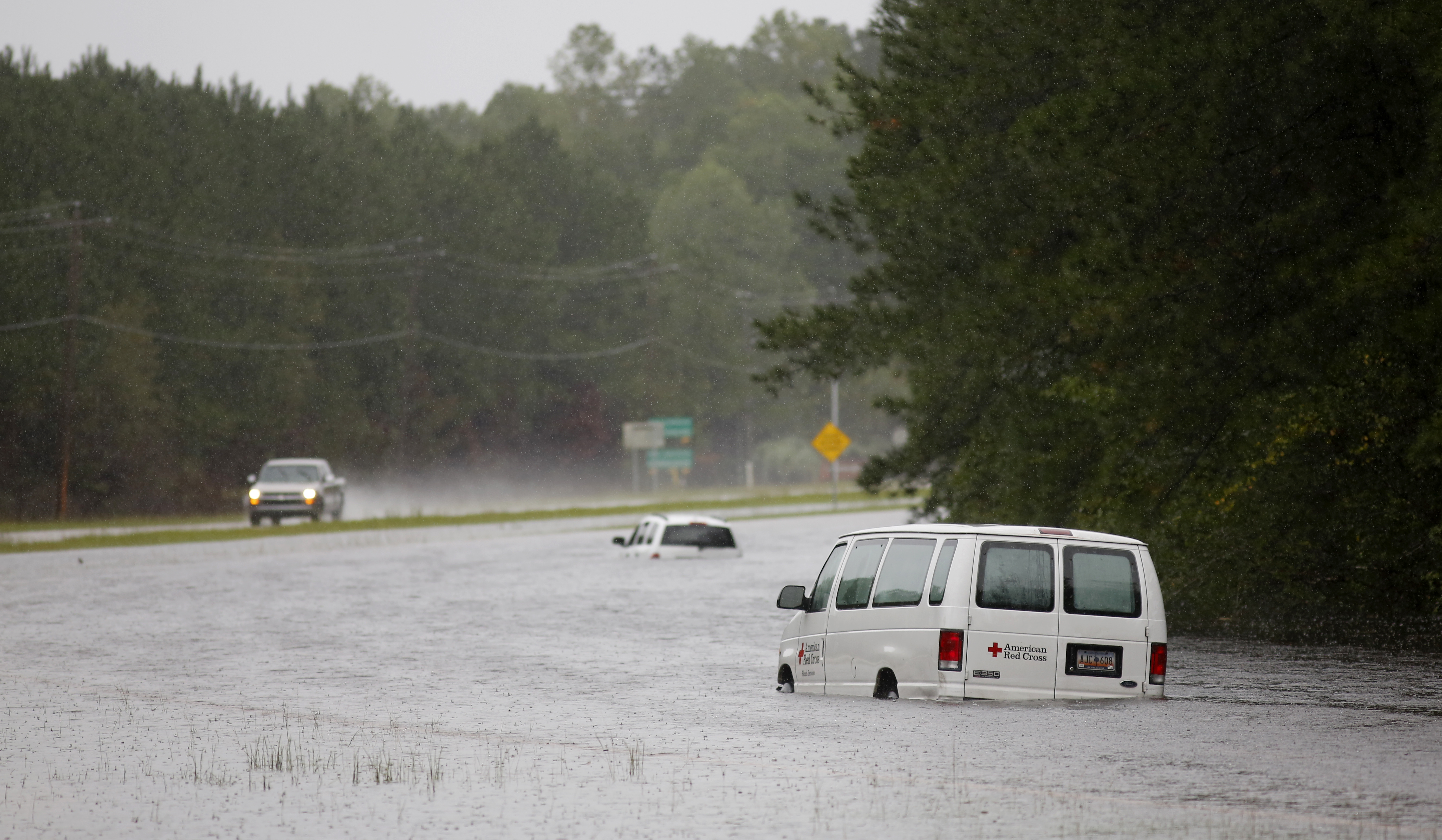 An American Red Cross van is stranded in floodwaters on U.S. Hwy. 17 North near Georgetown, S.C., Sunday, Oct. 4, 2015.