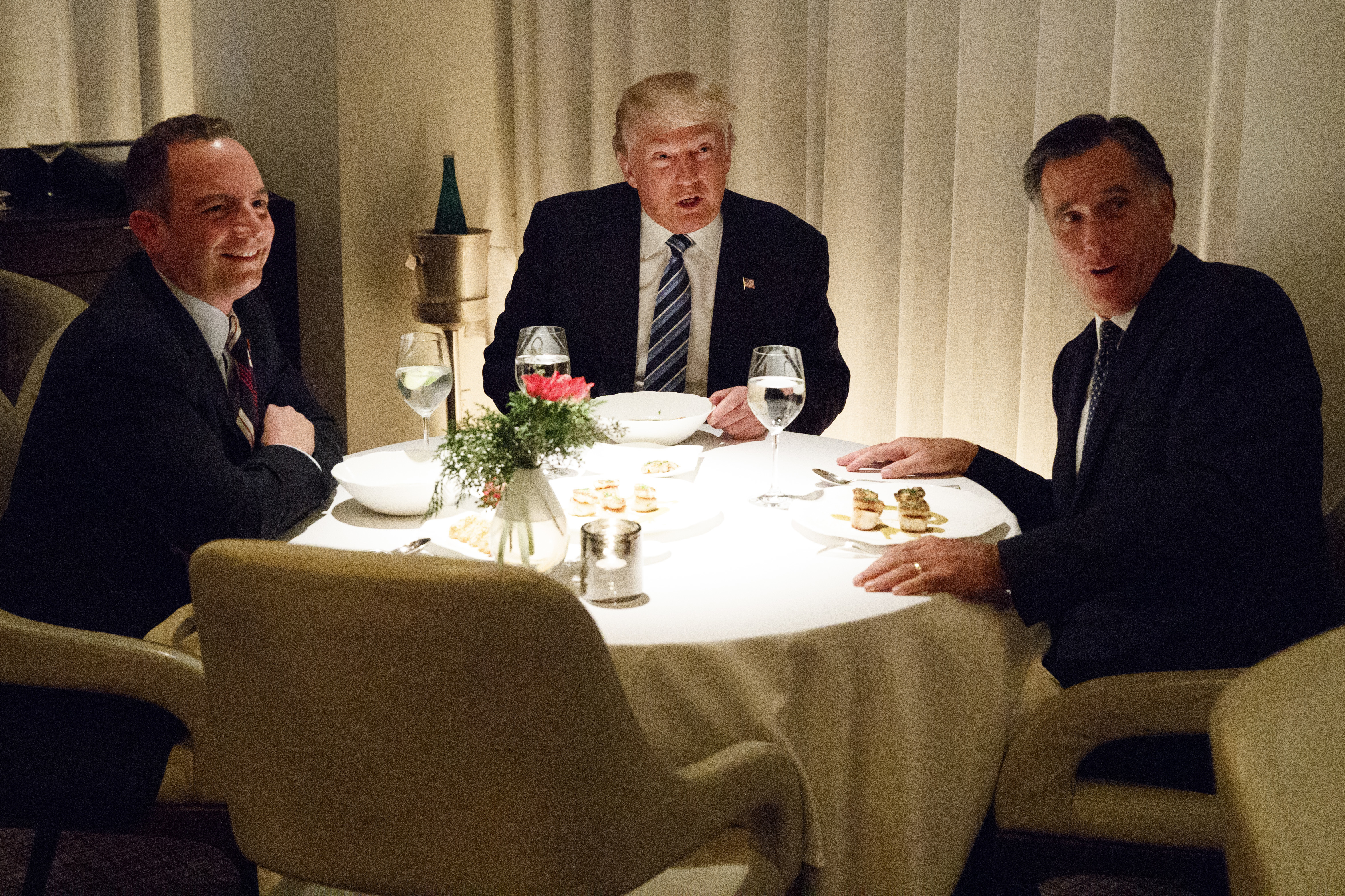 President-elect Donald Trump, center, eats dinner with Mitt Romney, right, and Trump Chief of Staff Reince Priebus at Jean-Georges restaurant, Nov. 29, 2016.