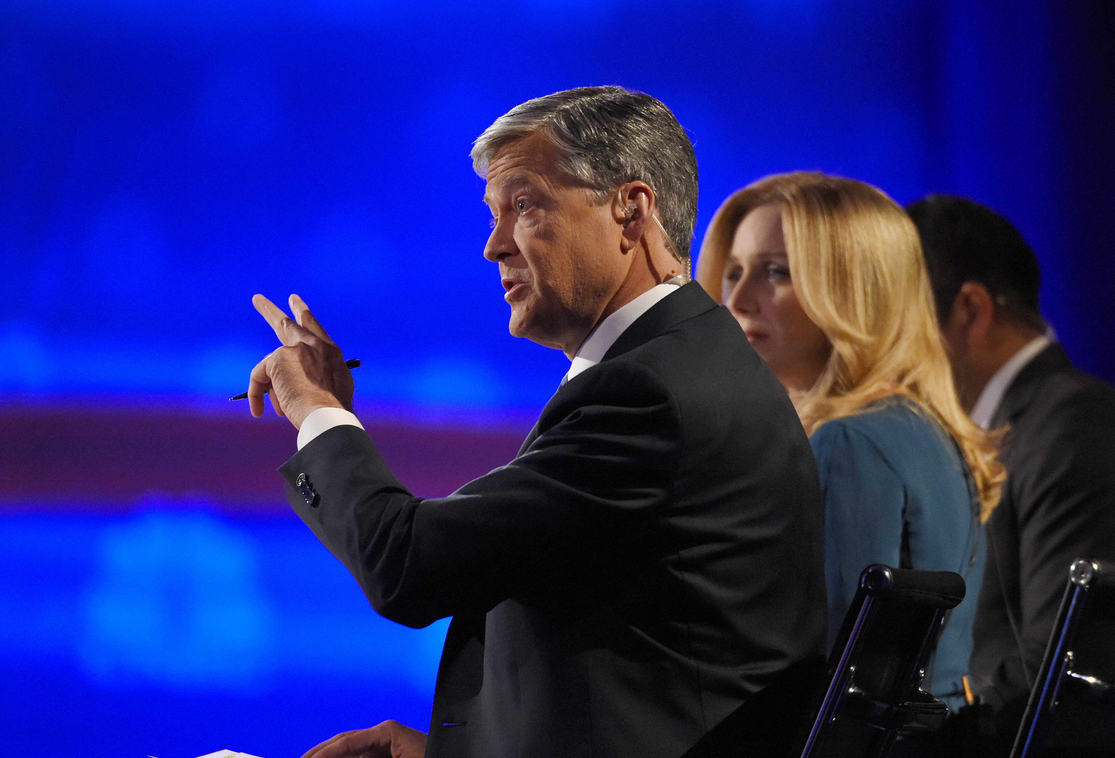 Debate moderators moderator John Harwood, left, moderator Becky Quick, center, and moderator Carl Quintanilla appear during the CNBC Republican presidential debate at the University of Colorado, Wednesday, Oct. 28, 2015.