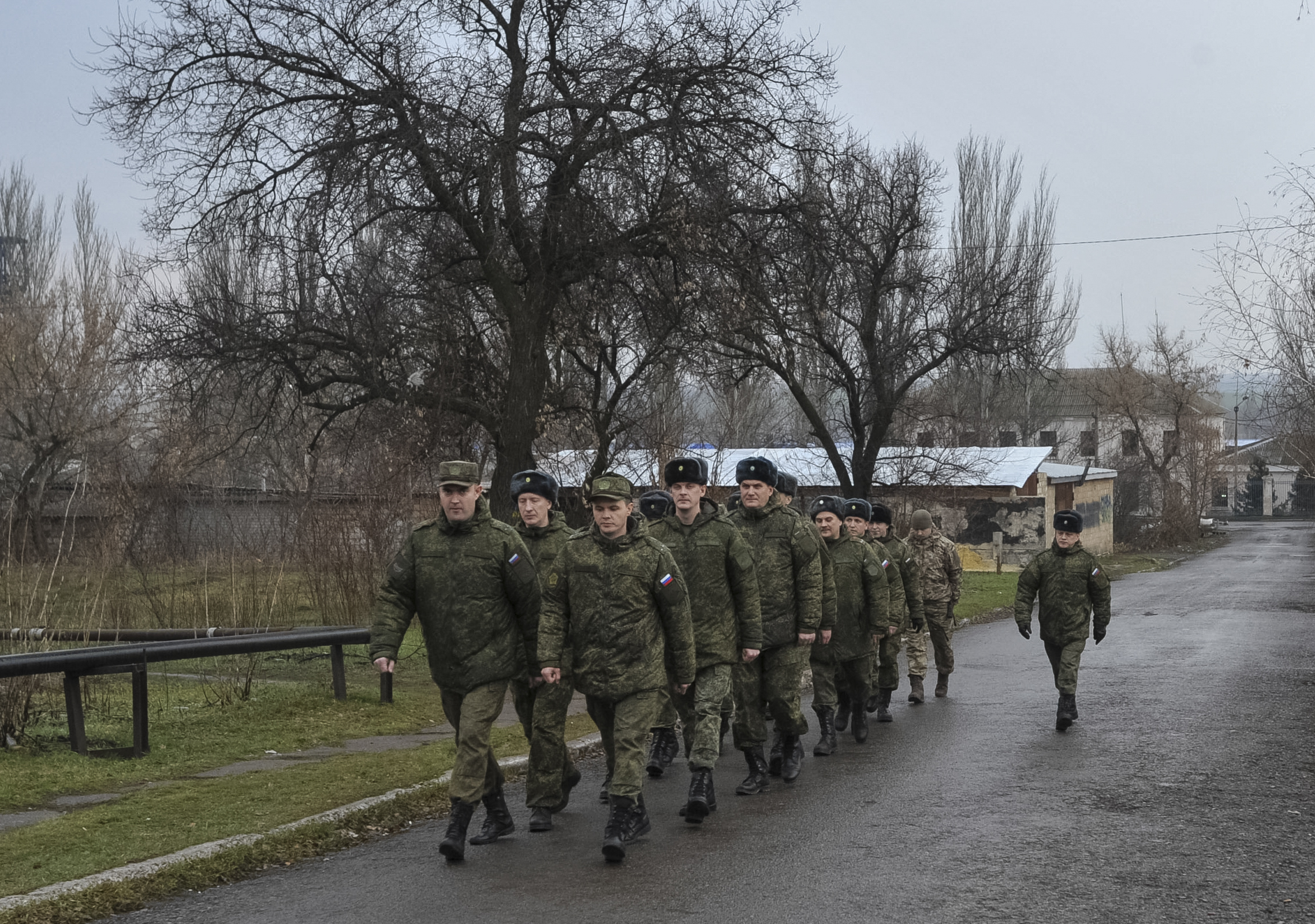 Russian military officers serving at the Joint Center for Control and Coordination (JCCC) march in the town of Soledar, Ukraine,  Dec. 17, 2017.